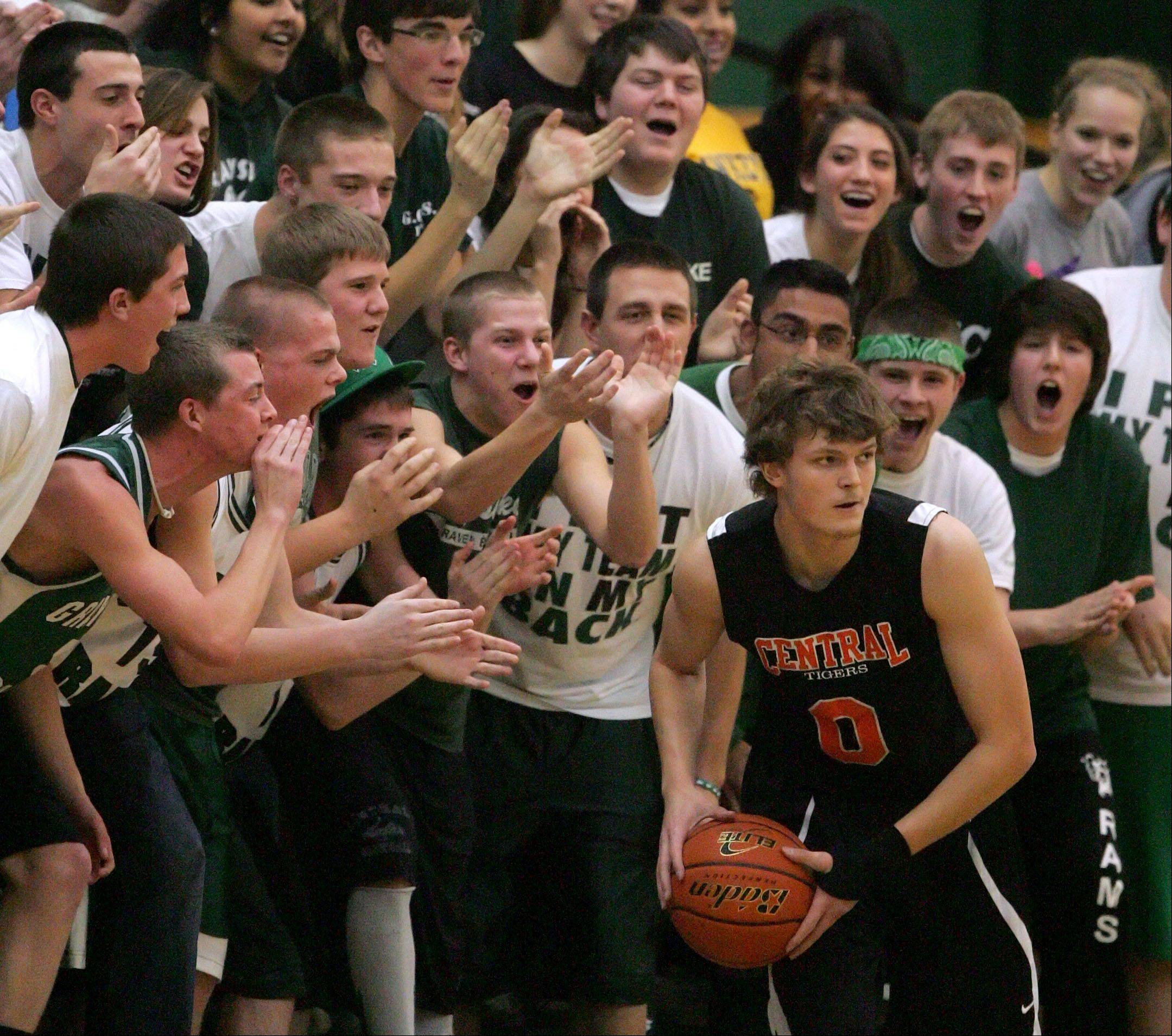 Grayslake Central's fans attempt to bother Crystal Lake Central's Nick Decoster on an inbound pass.