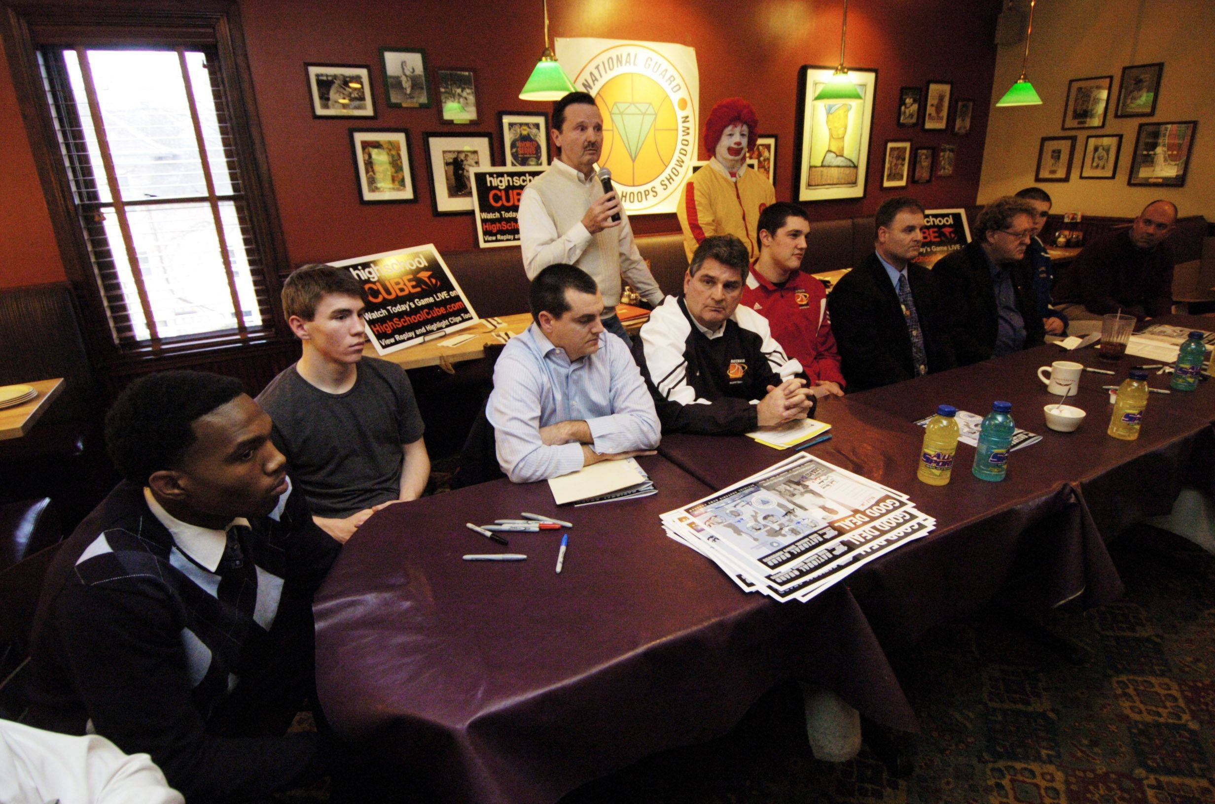 Head coaches and players from participating teams gather during a Hoops Showdown press conference at Lou Malnati's in Schaumburg Tuesday.
