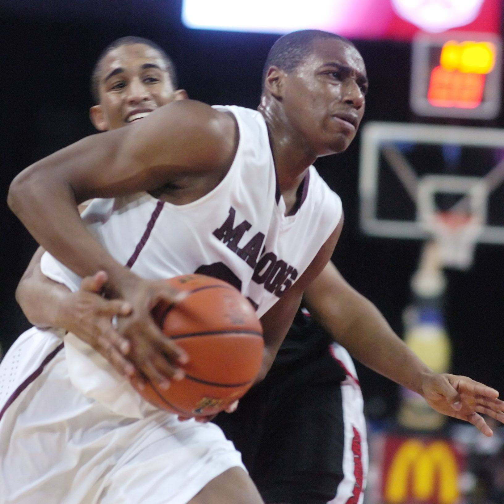 Elgin senior Kory Brown, who tied his career high with 30 points, drives to the basket during the Maroons' 58-44 win over Huntley at Saturday's High School Hoops Showdown game at the Sears Centre in Hoffman Estates.