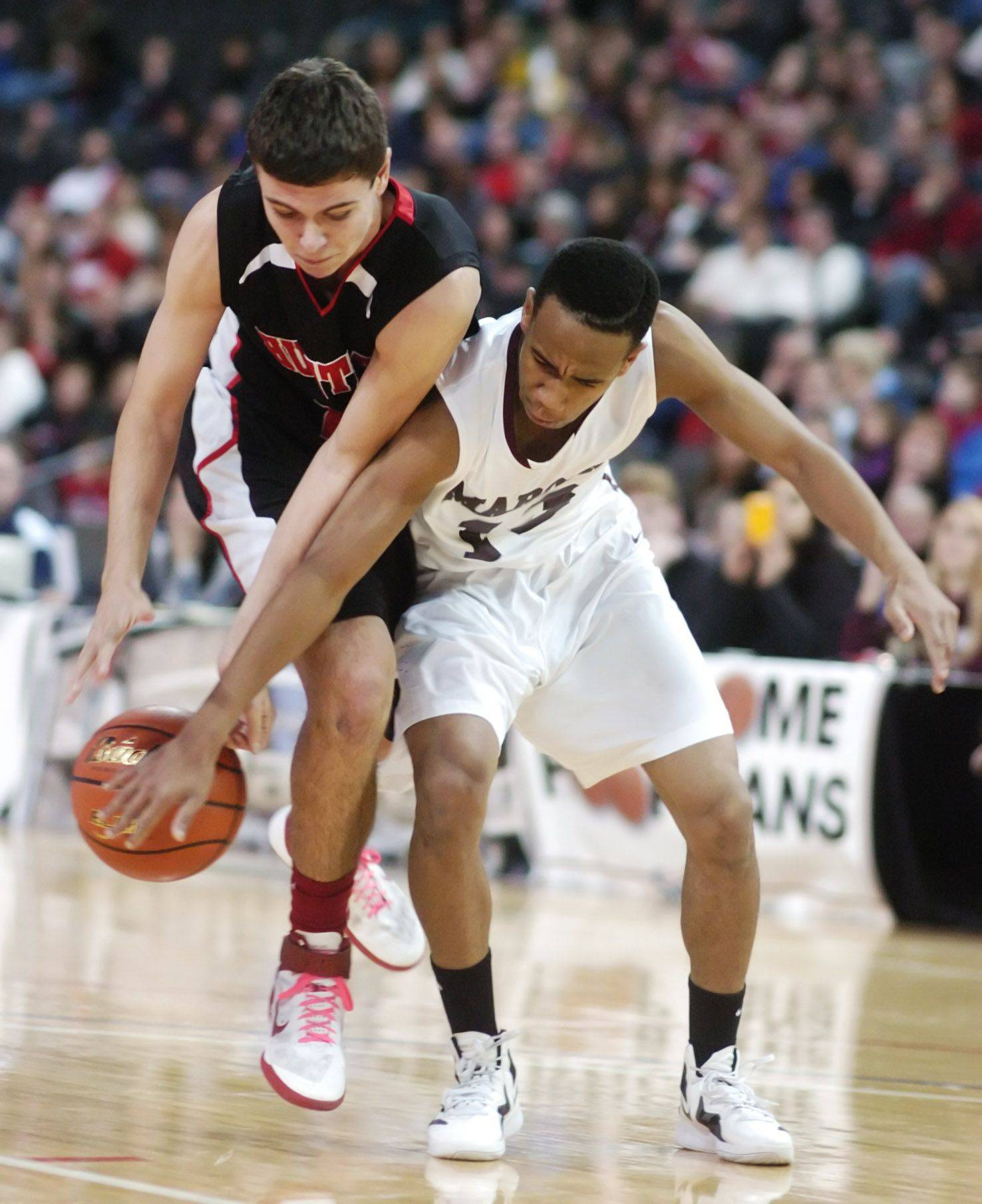Elgin's Cortez Scott, right, prevents a move to the basket by Huntley's Ryan Craig during Saturday's High School Hoops Showdown game at the Sears Centre in Hoffman Estates.
