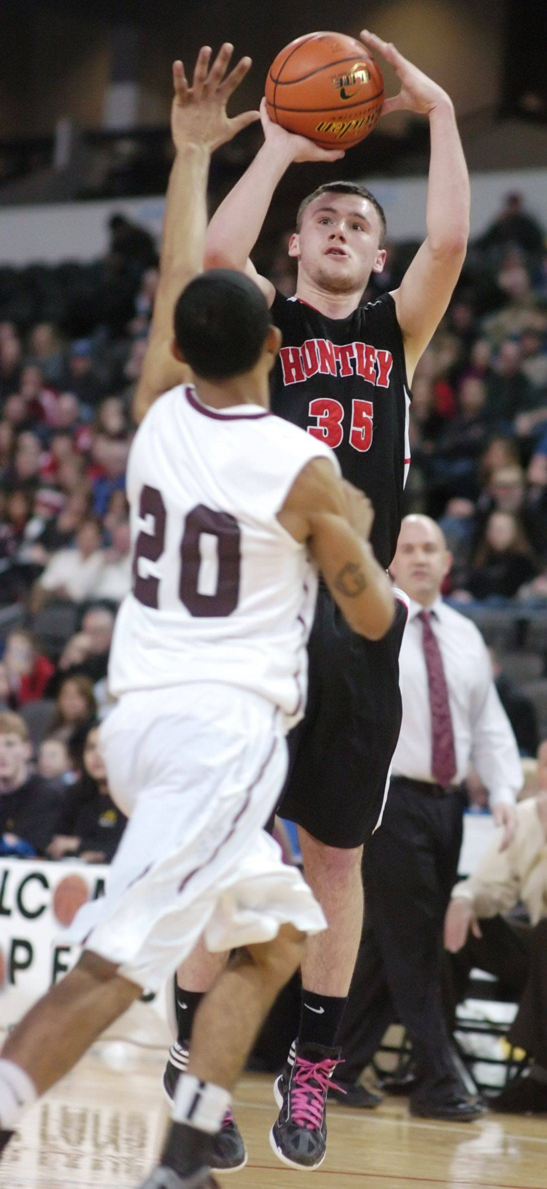 Huntley's Justin Frederick takes a shot as Elgin's Devin Gilliam defends during Saturday's High School Hoops Showdown game at the Sears Centre in Hoffman Estates.