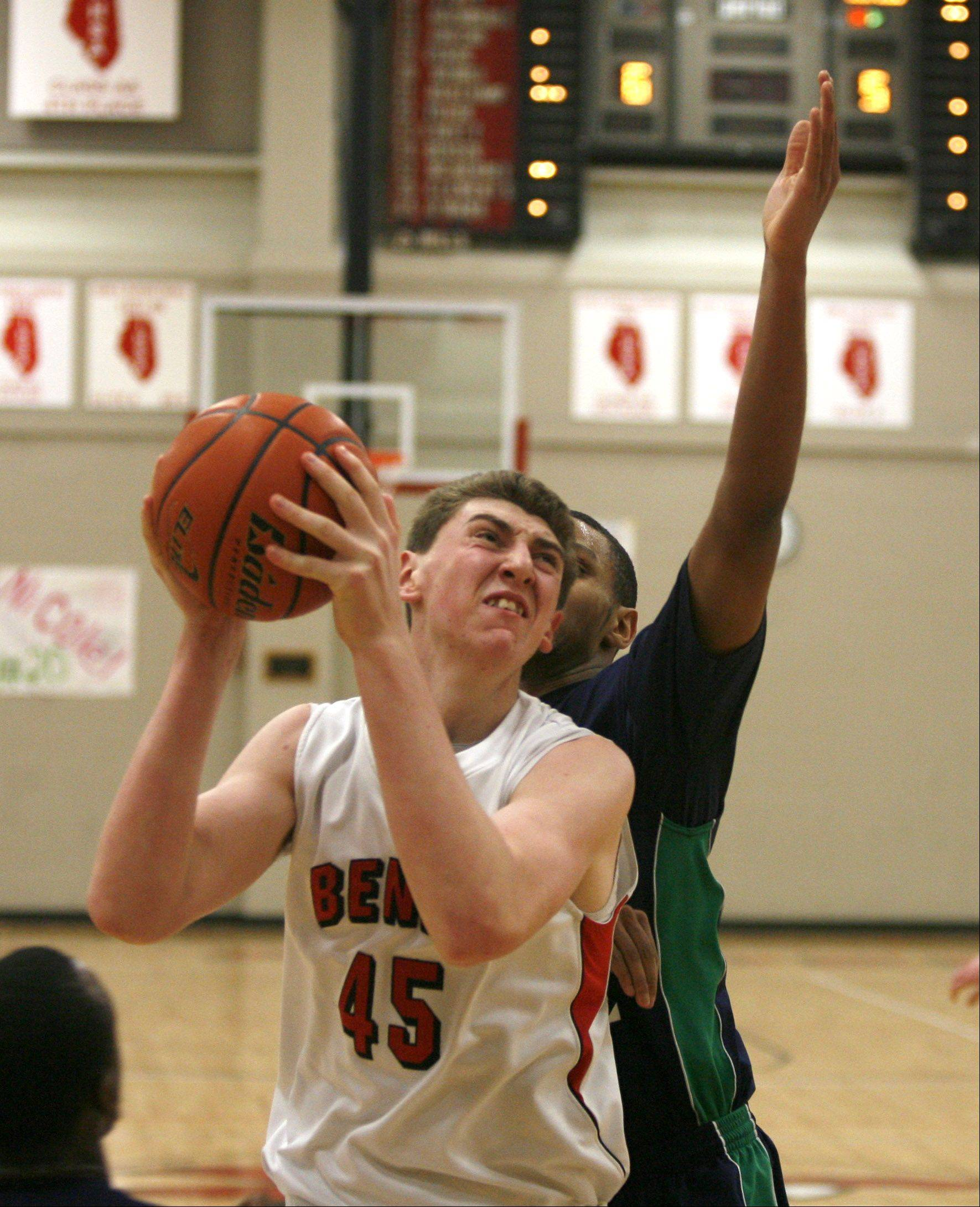 Benet Academy's Sean O'Mara, drives to the basket during boys basketball action against Notre Dame.