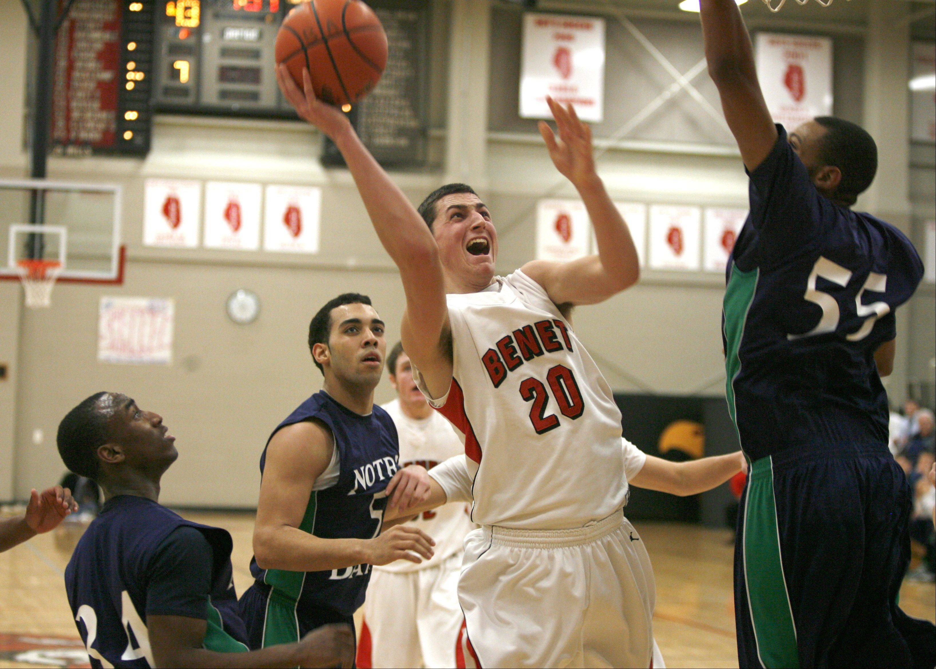 Benet Academy's Bobby Wehrli (20) works inside against Notre Dame, during boys basketball action in Lisle.
