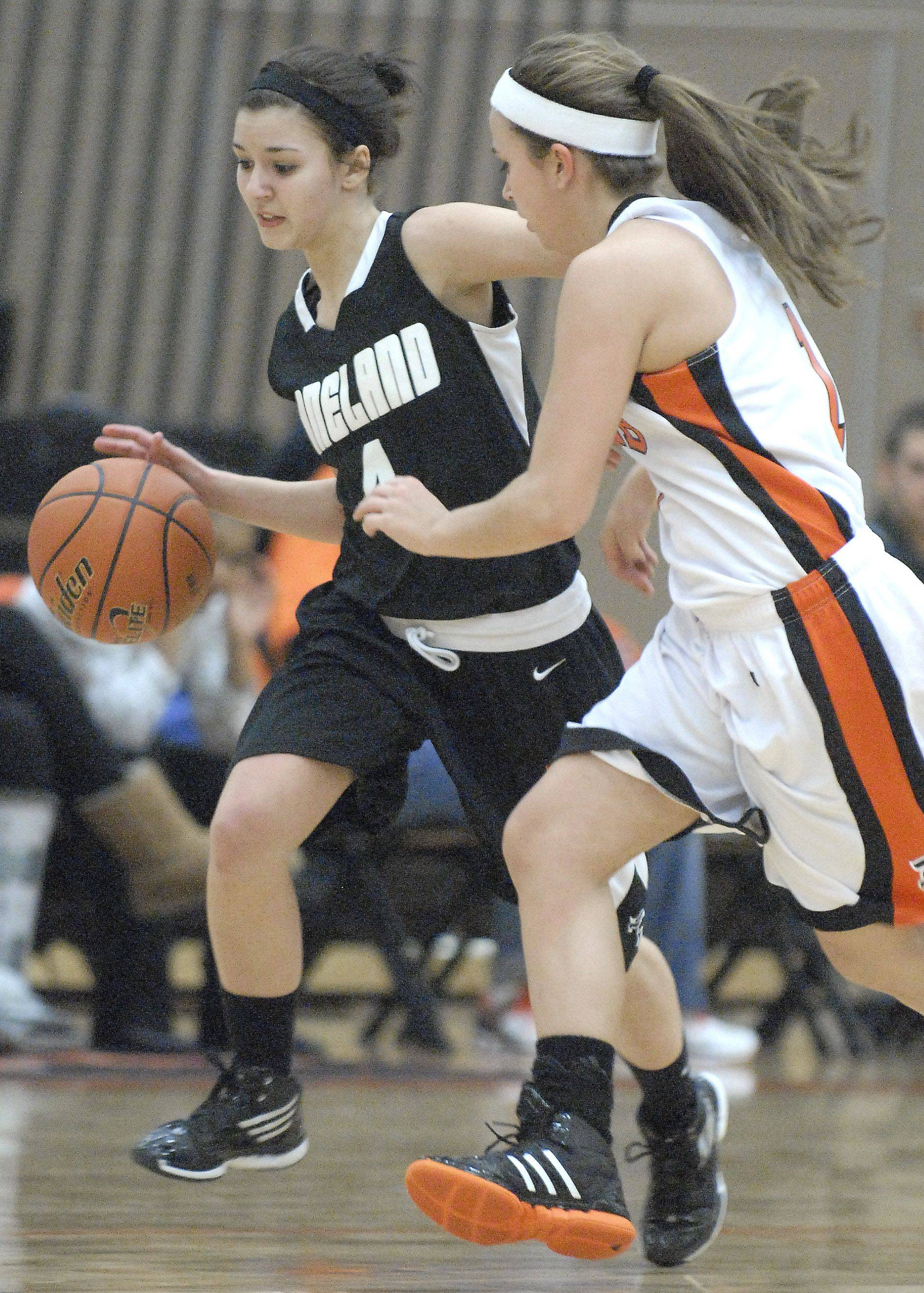 Laura Stoecker/lstoecker@dailyherald.comKaneland's Alli Liss runs head to head on the way to the hoop with DeKalb's Alli Smith in the third quarter on Tuesday, January 31.