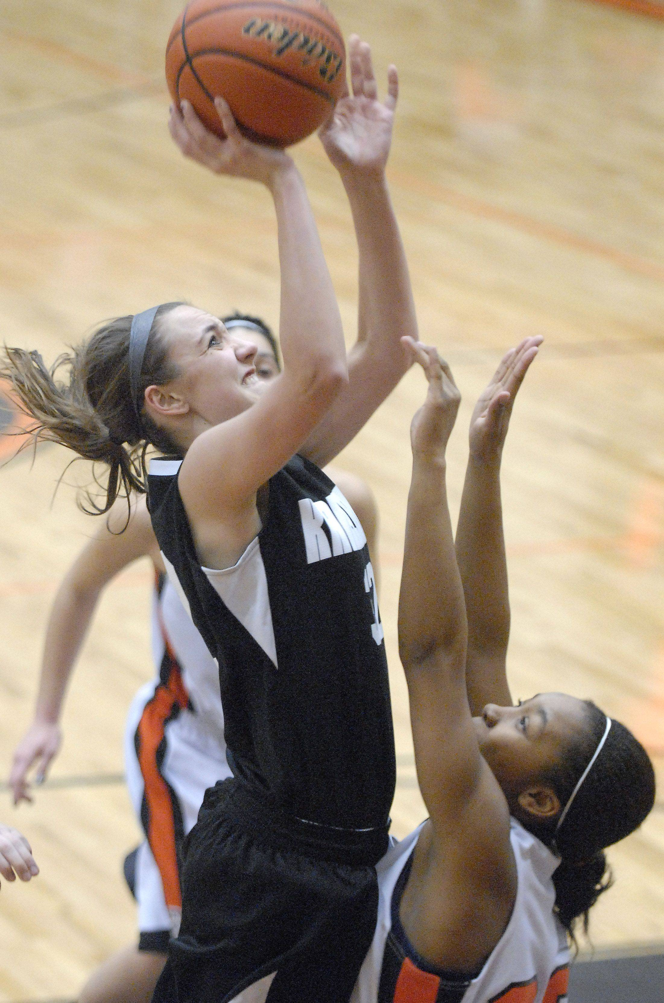 Kaneland's Emma Bradford shoots over a block by DeKalb's Courtney Patrick in the first quarter.