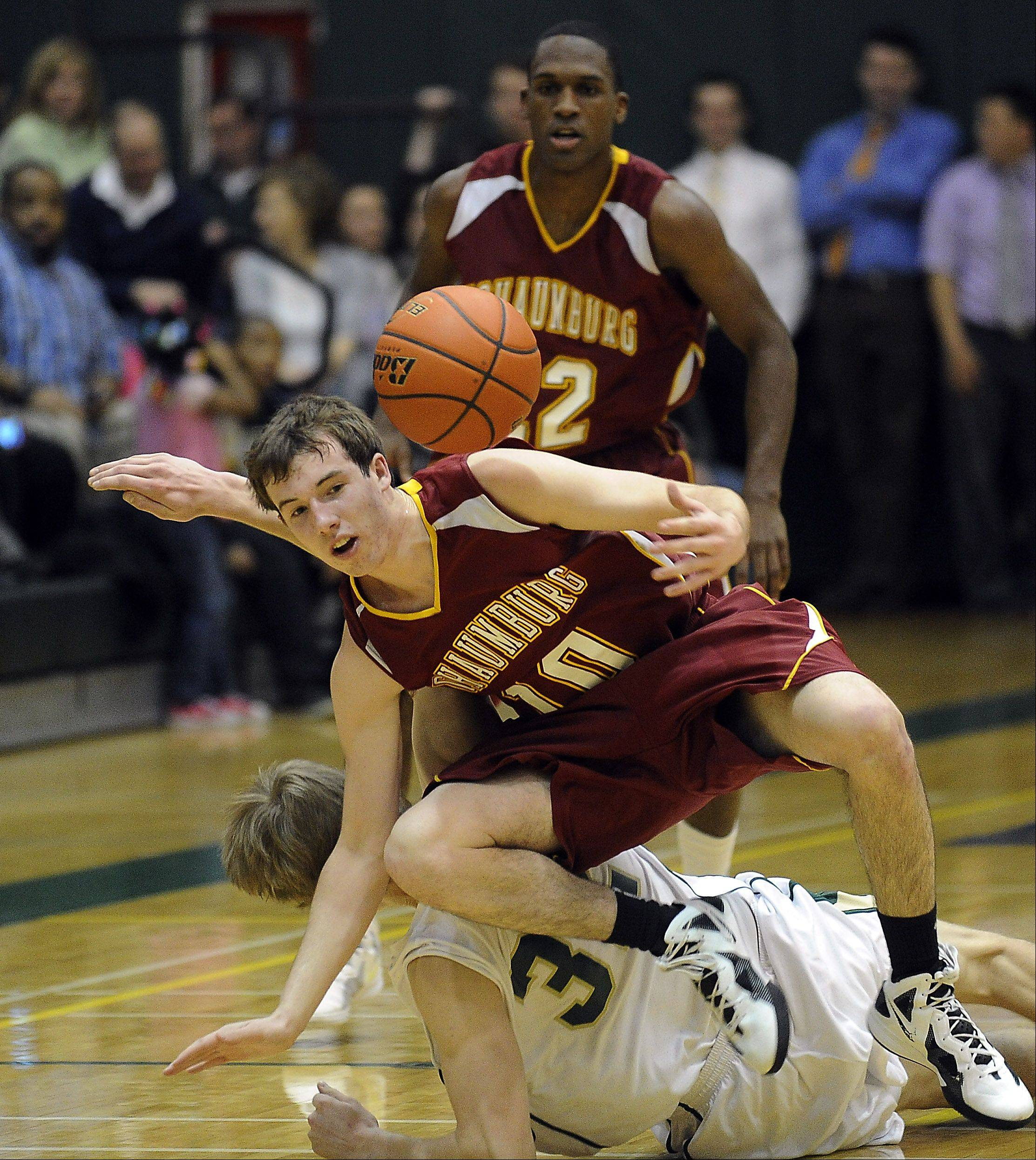 Schaumburg's Joey Faleni and Fremd's Nate Serviss battle for a loose ball in the first half.