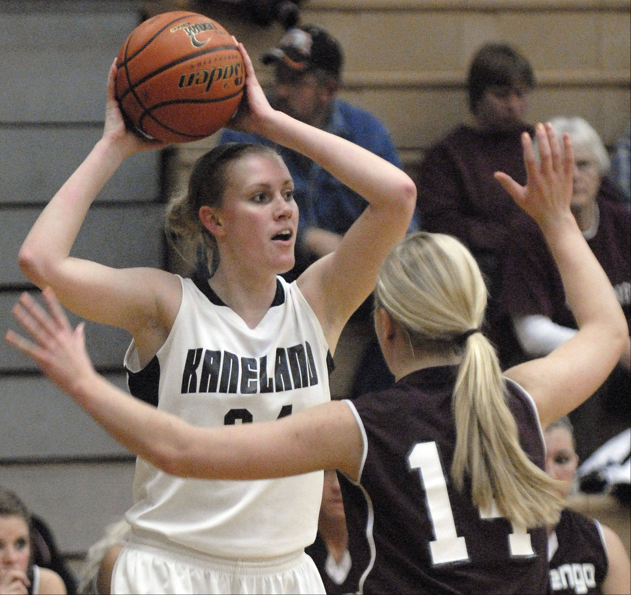 Kaneland's Kelly Evers looks to pass over Marengo's Allison Rogutich in the first quarter on Tuesday, February 7.