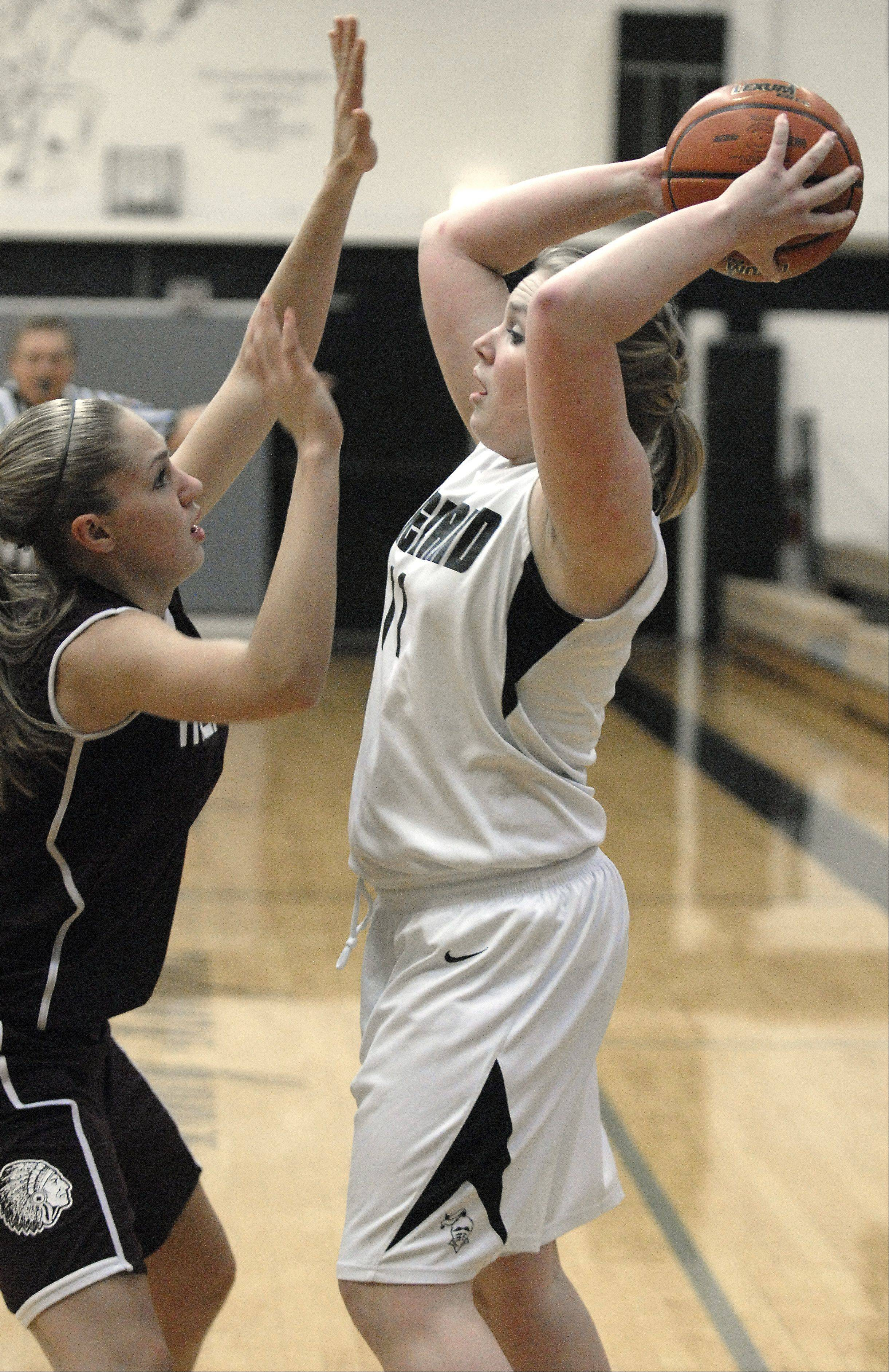 Kaneland's Ashley Post looks to pass around Marengo's Jessica Ville in the first quarter on Tuesday, February 7.
