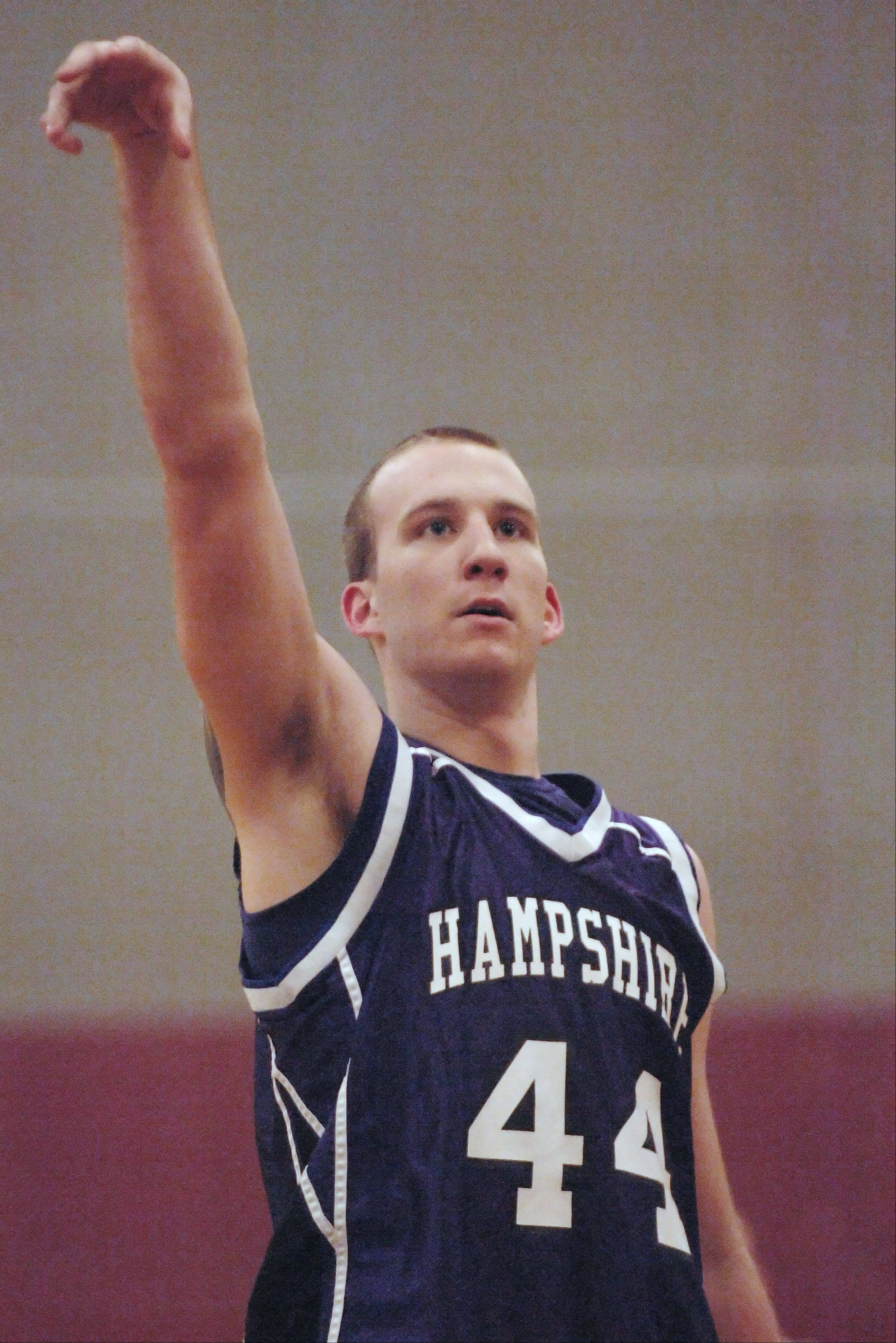 Hampshire's Tyler Watzlawick watches his free throw drop through the net for his 1,000th career point Tuesday in Marengo.