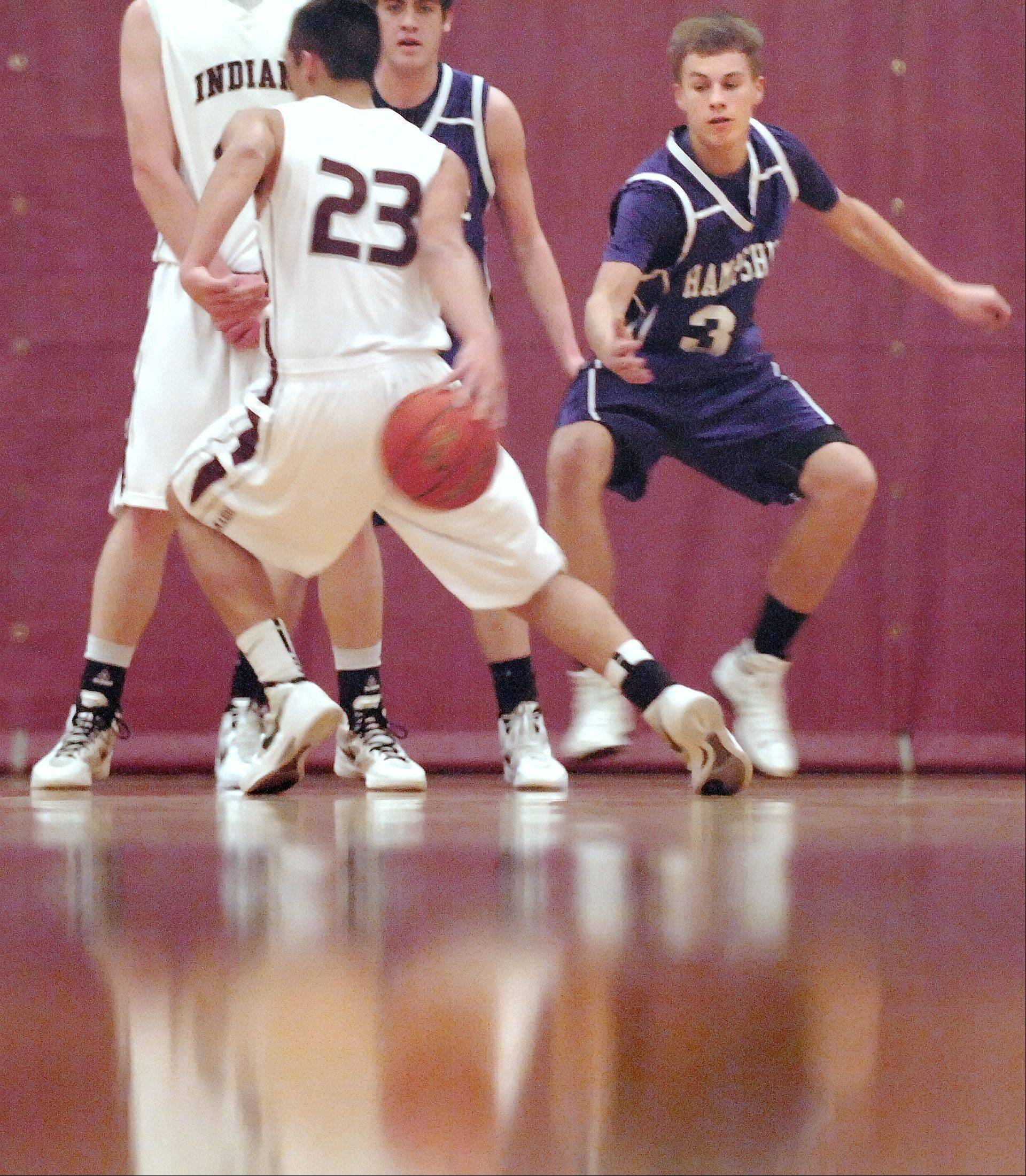 Marengo's Nick Ollero escapes the defense of Hampshire's Ryan Cork by dribbling behind his back Tuesday in Marengo.