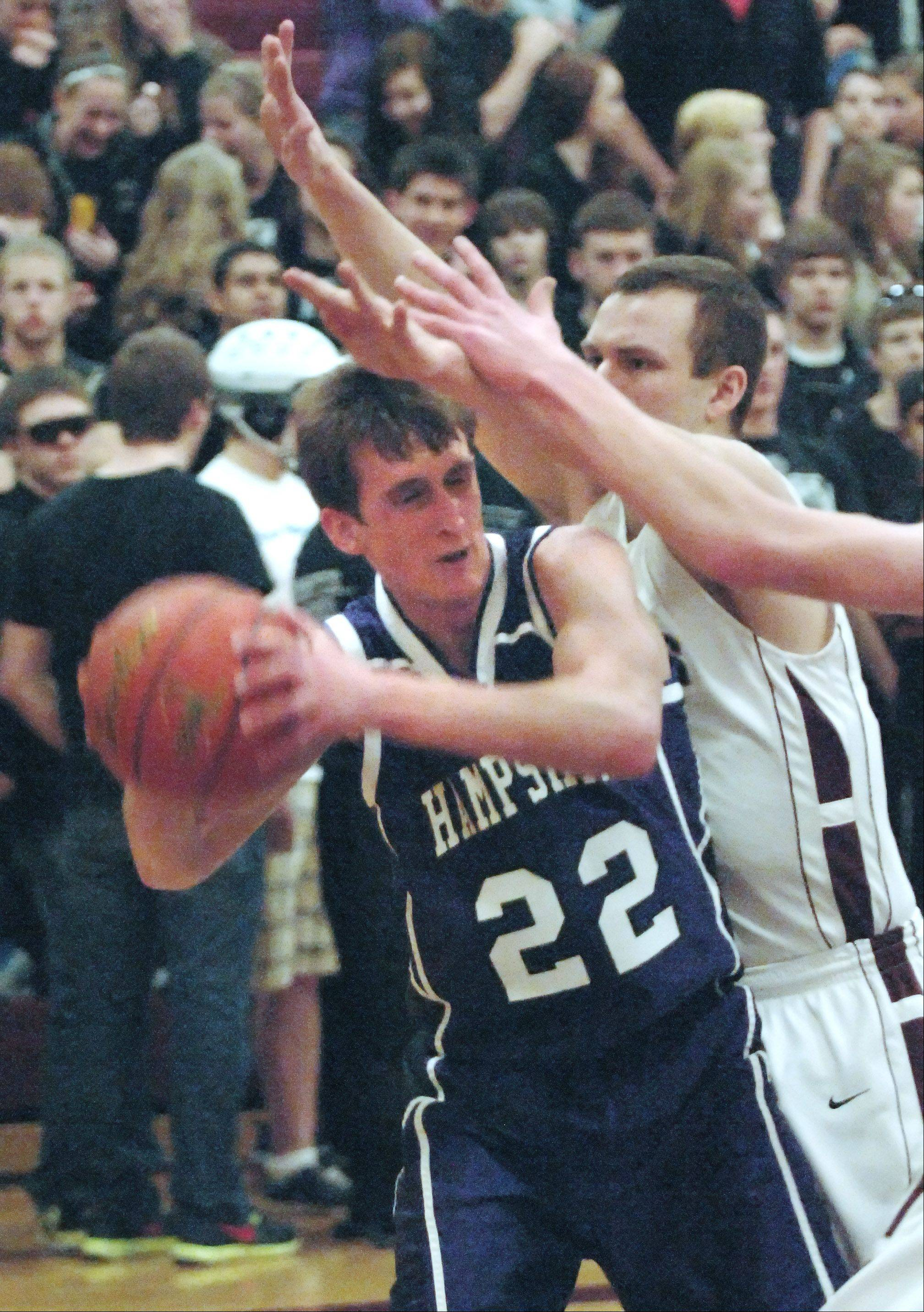 Hampshire's Brendan Waterworth is forced to look for a teammate under the basket as Marengo's Anthony Mallegni guards him Tuesday in Marengo.