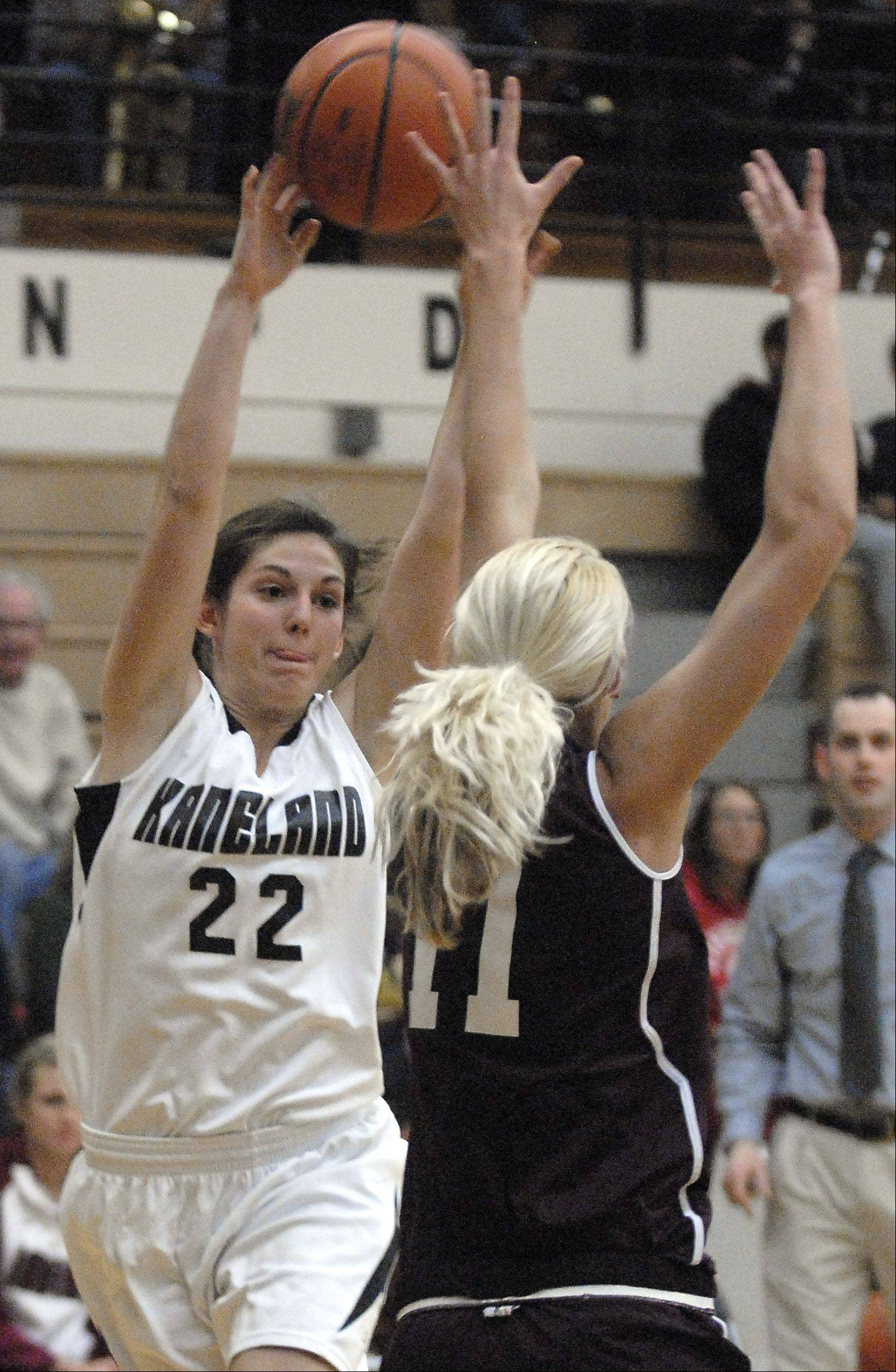 Marengo's Ally Fillmore attempts to block a pass by Kaneland's Brooke Harner in the first quarter.