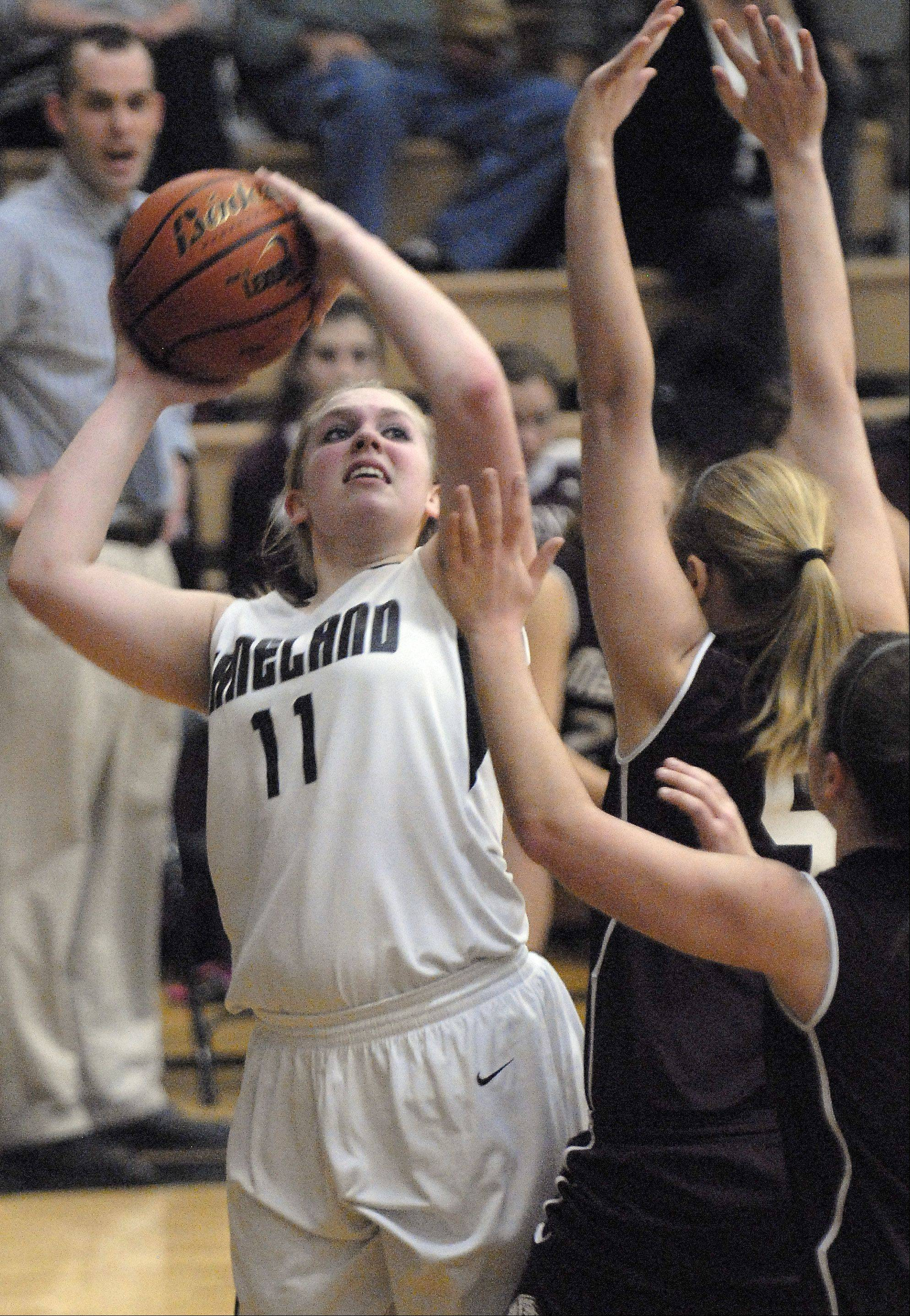 Kaneland's Ashley Post aims for the hoop over Marengo's Courtney Tremmel in the second quarter.