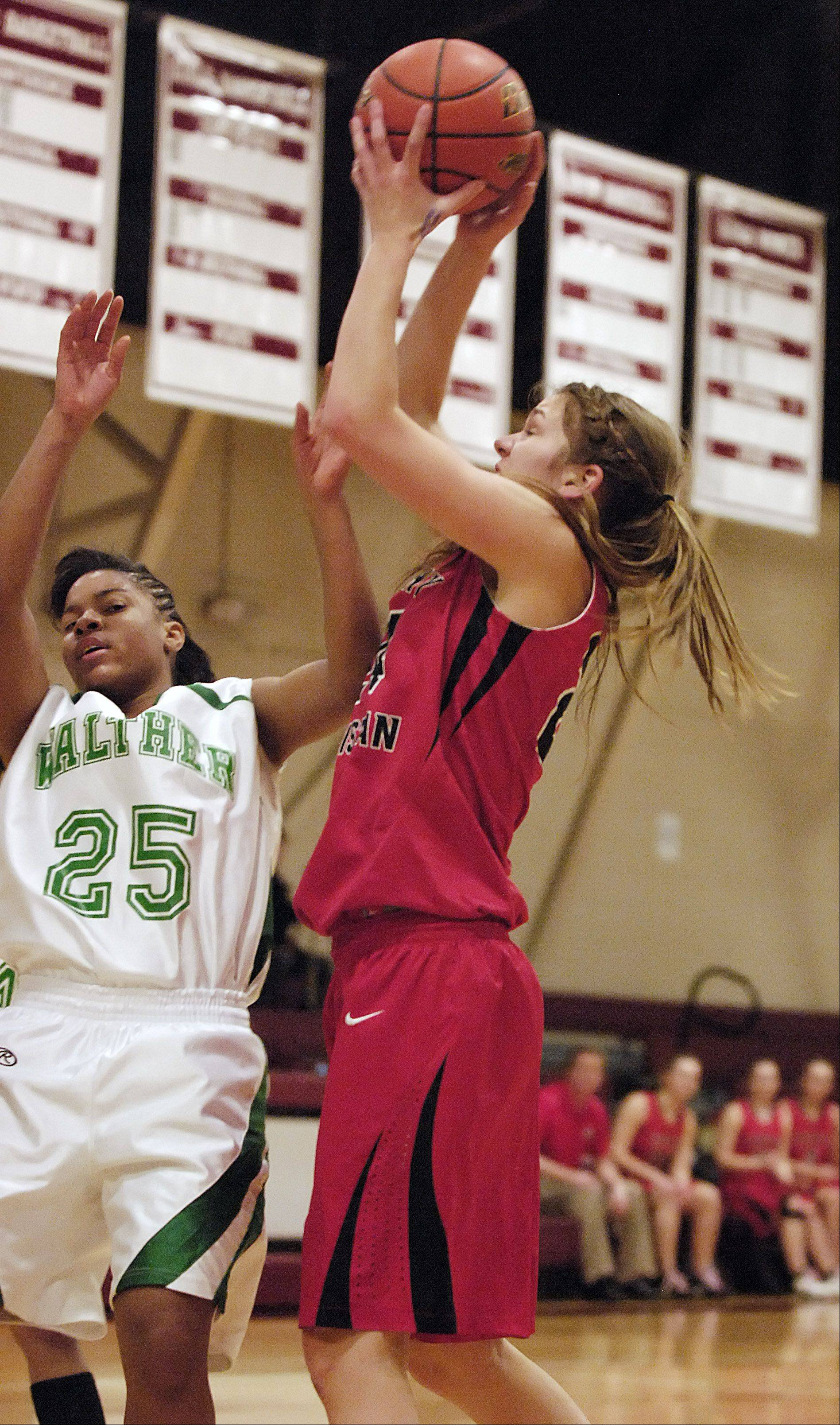 Tessa Bosman of Timothy Christian takes a shot over Dana Turner of Walther Lutheran.