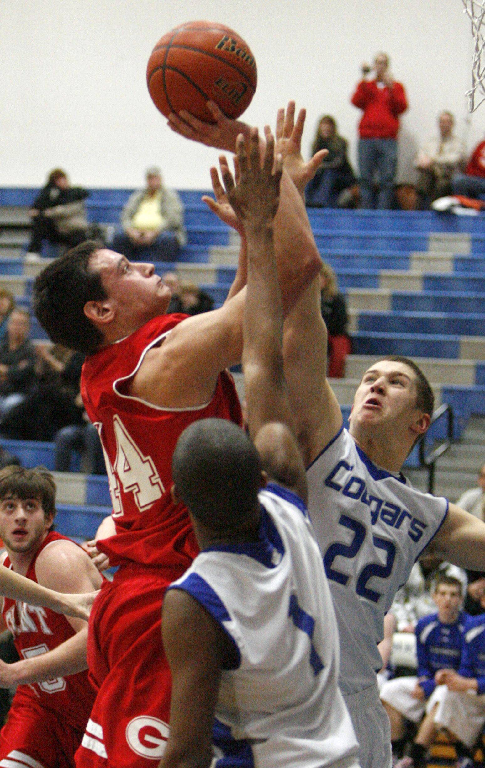 Grant's Brandon Lombardino drives the lane and shoots against Vernon Hills' Jarrett Wood.