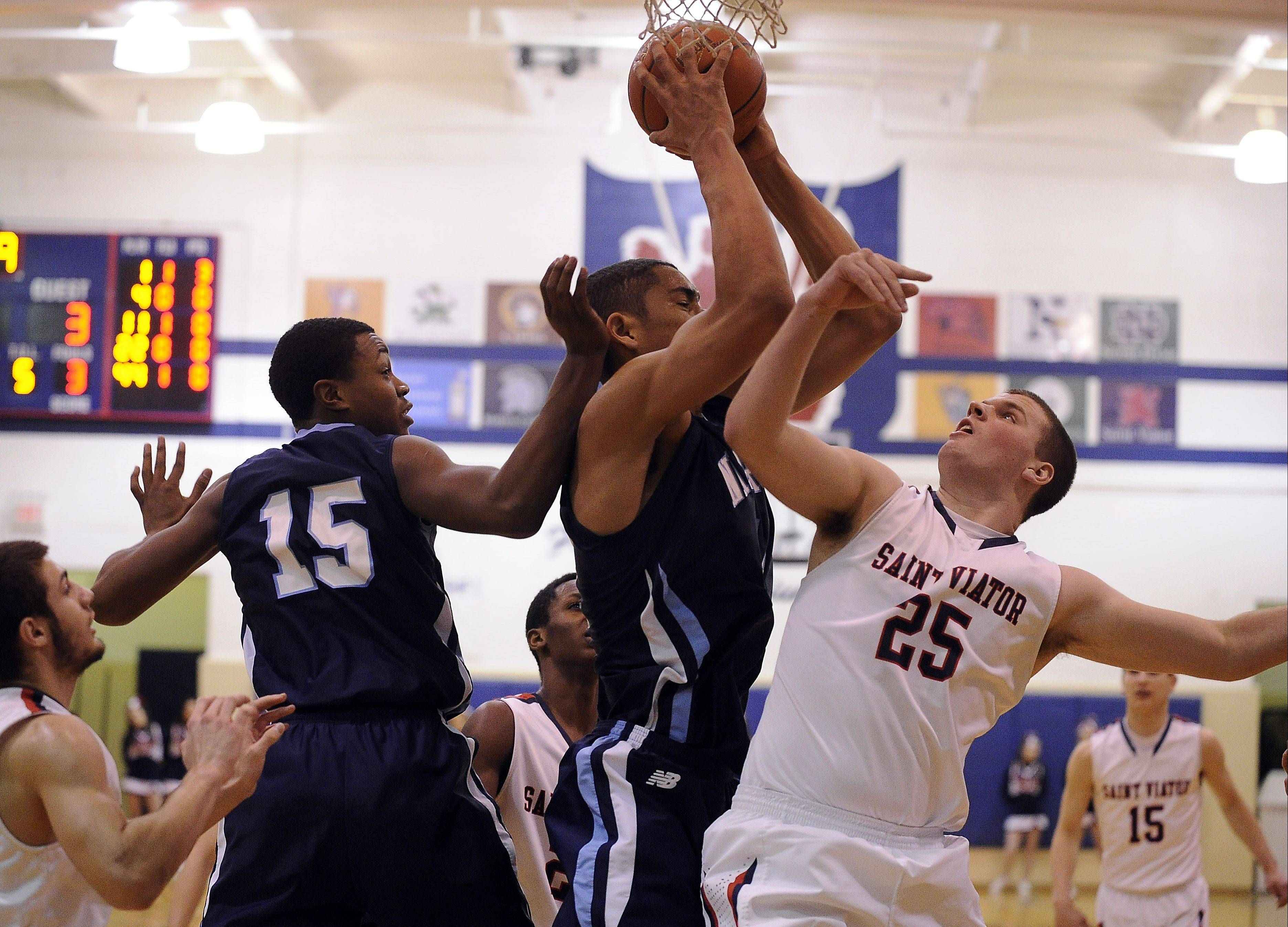 St. Viator's Hugh Masterson battles with Nazareth's Tyler Jackson for the rebound in the first half at St. Viator on Monday.