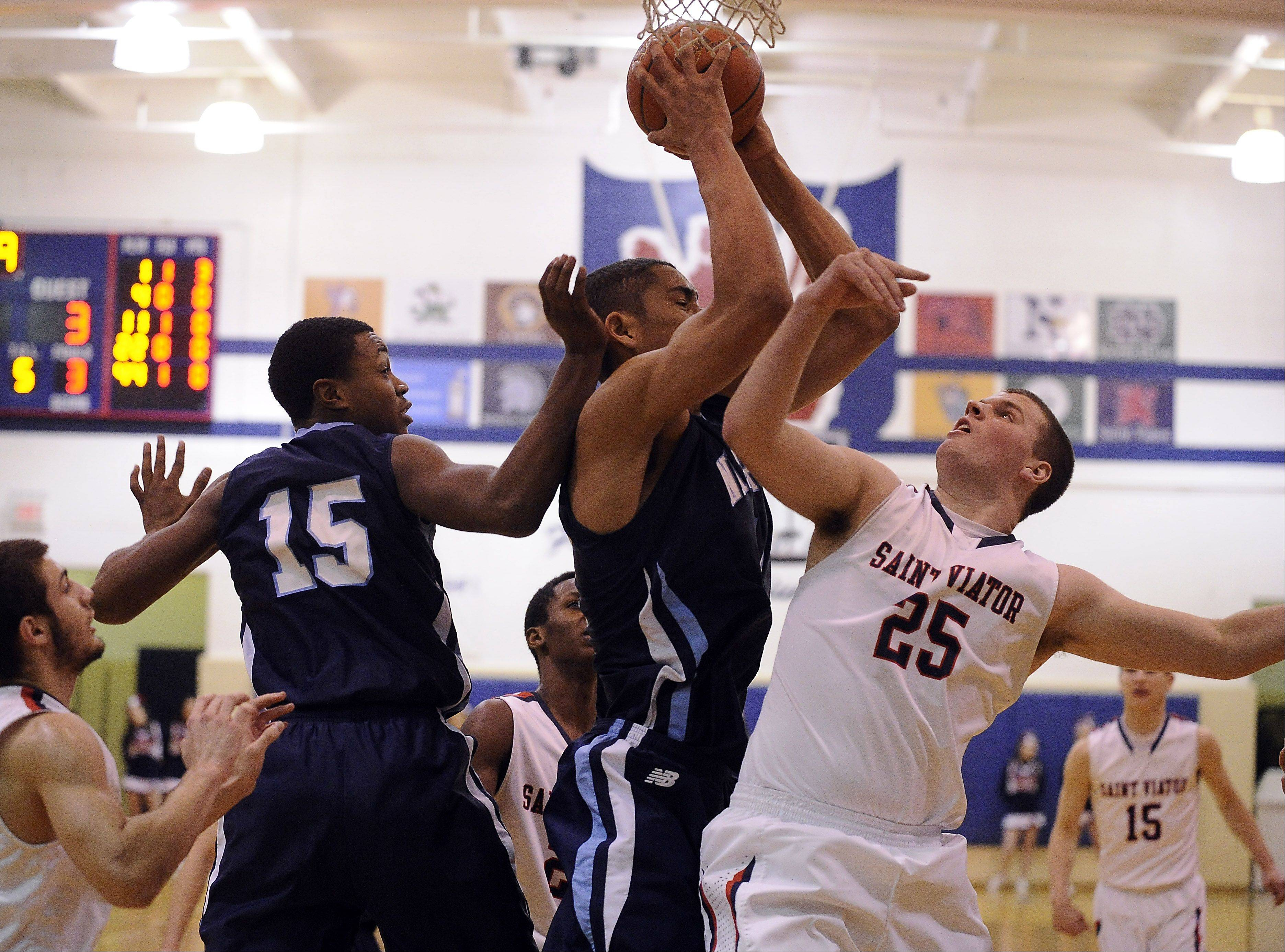 St. Viator's Hugh Masterson battles with Nazareth's Tyler Jackson for a rebound in the first half.