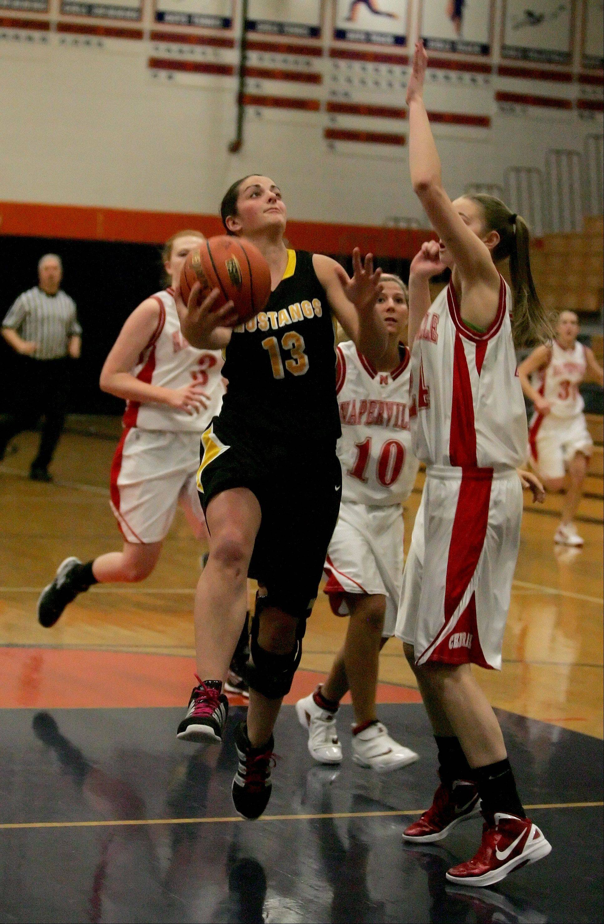 Megan Geldernick of Metea Valley goes up to make a basket against Naperville Central in Class 4A girls basketball regional action in Oswego on Tuesday.