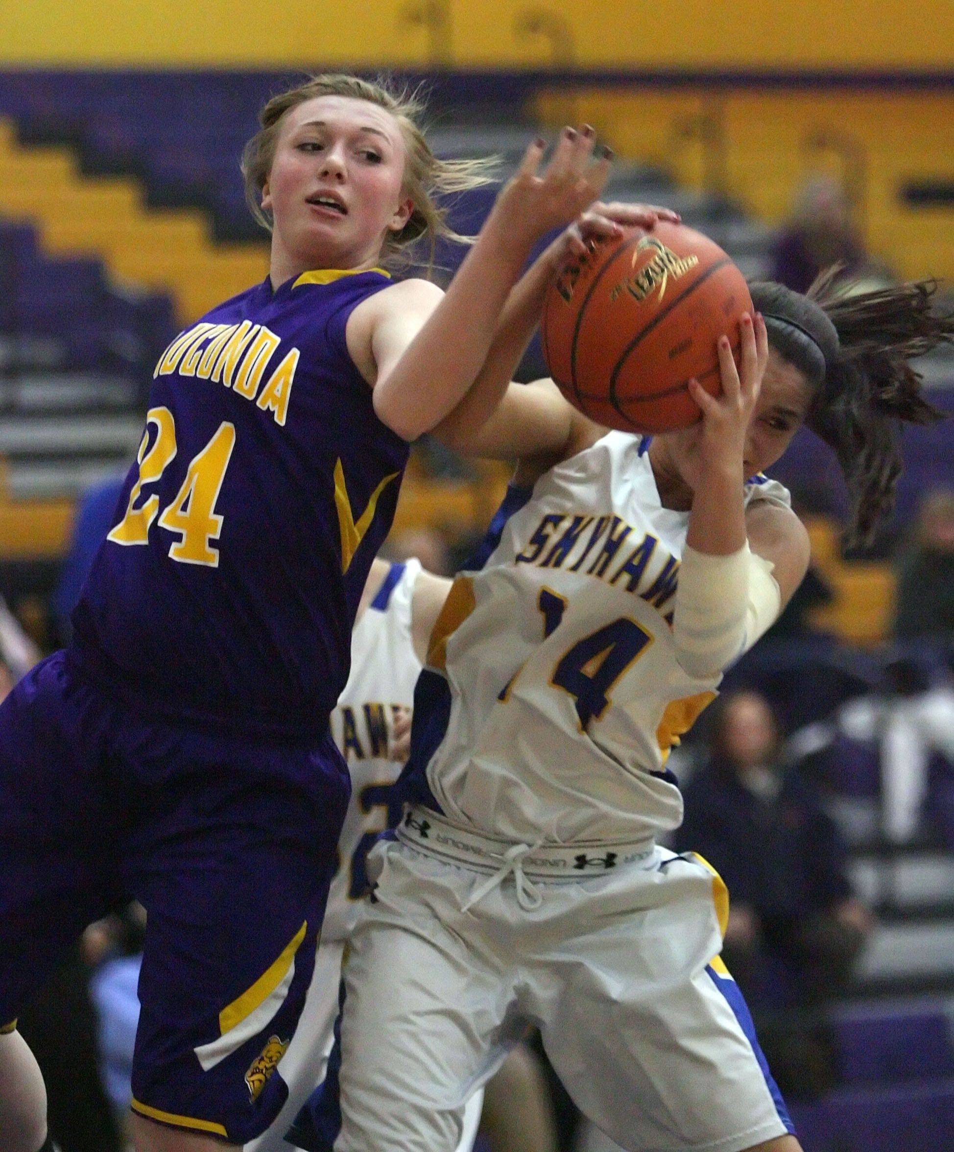 Wauconda's Melissa Latham, left, and Johnsburg's Tayelor Neiss battle for a rebound.