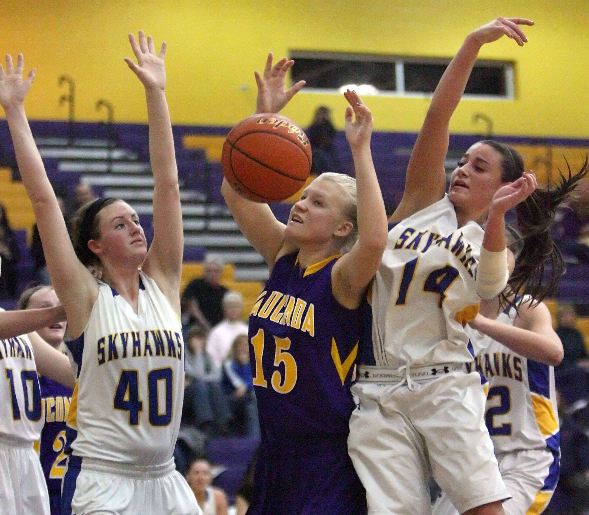 Wauconda's Lexie Redmann, center, battles for a rebound with Johnsburg's Ashley Schuld, left, and Tayelor Neiss on Wednesday night at Wauconda.