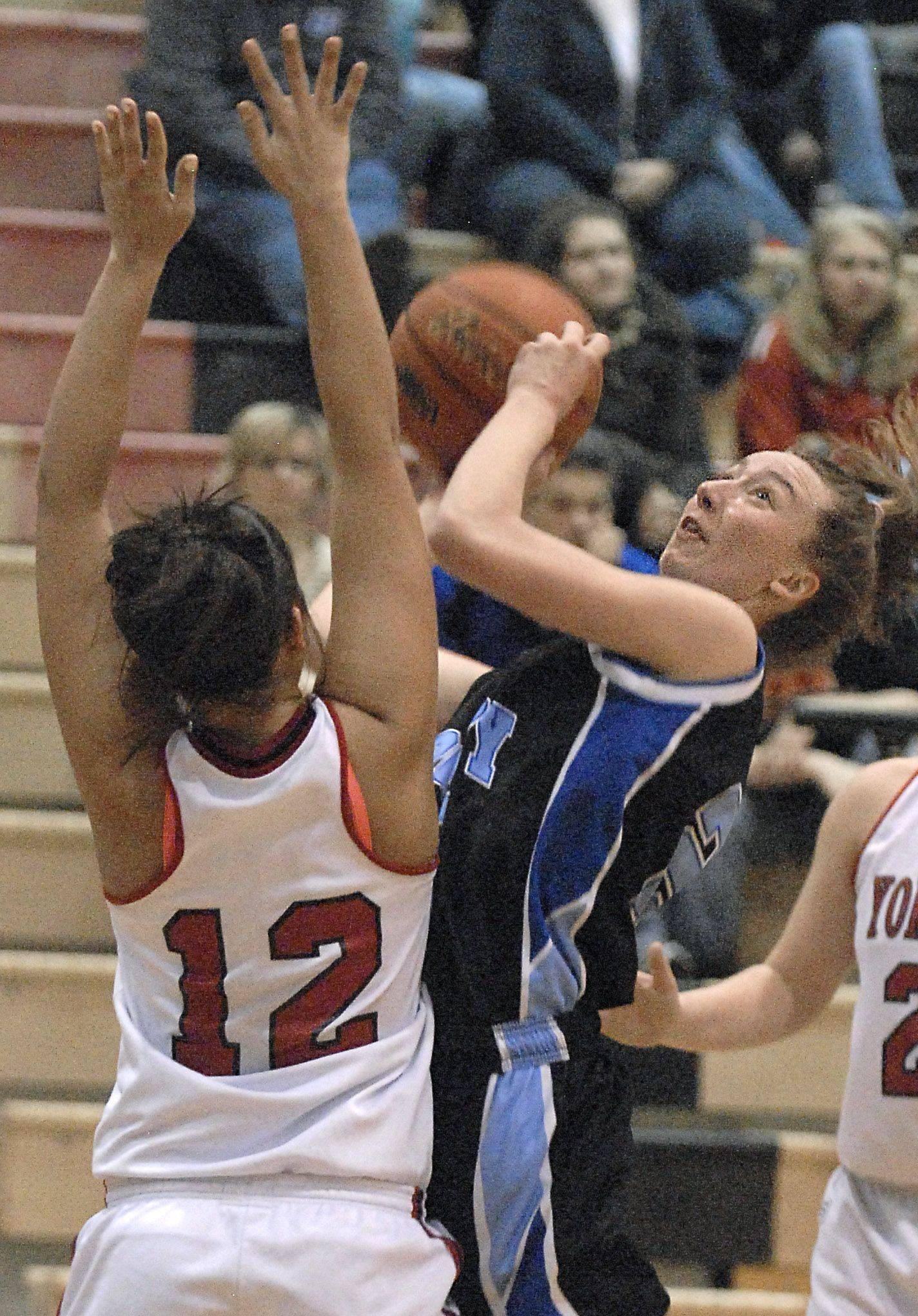 Rosary's Mary Wentworth is fouled by Yorkville's Paige Beach as she goes up for a shot in the third quarter on Wednesday, February 15.