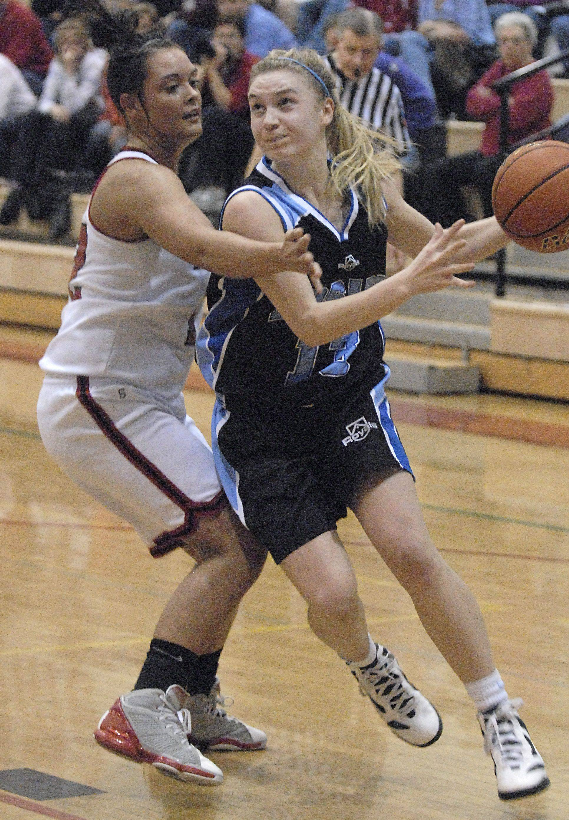 Laura Stoecker/lstoecker@dailyherald.comRosary's Karly Tate circles around a block by Yorkville's Paige Beach in the second quarter of regional game on Wednesday, February 15.