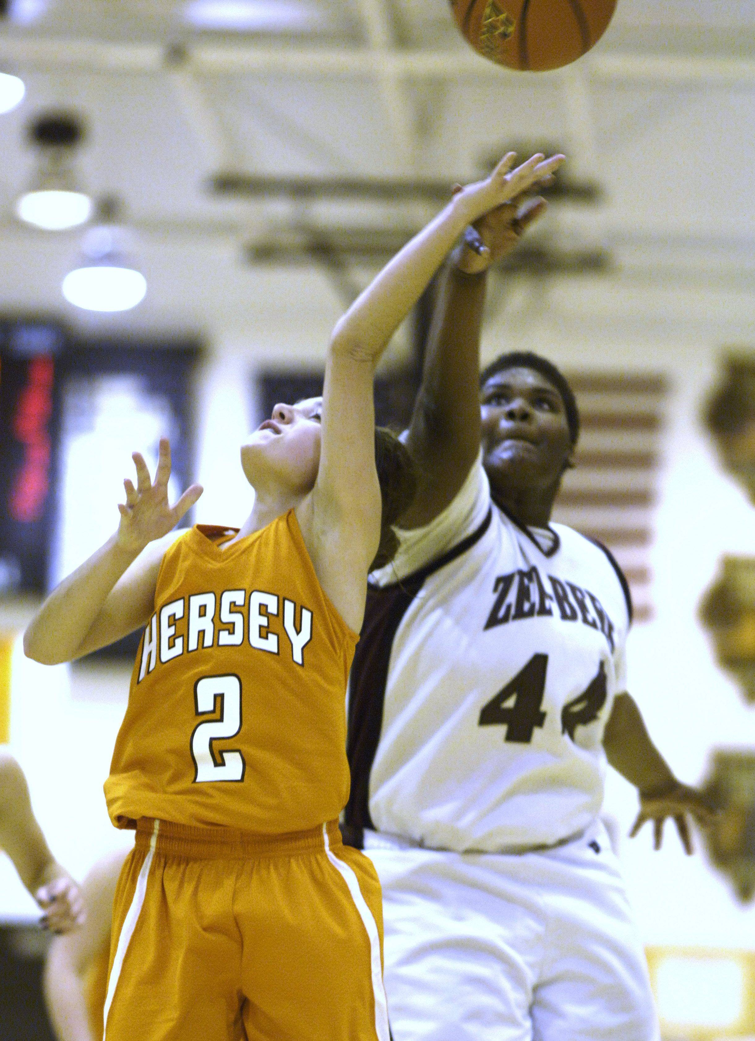 Hersey's Jen Hall, left, is blocked by Zion-Benton's Aaliyah Smith .