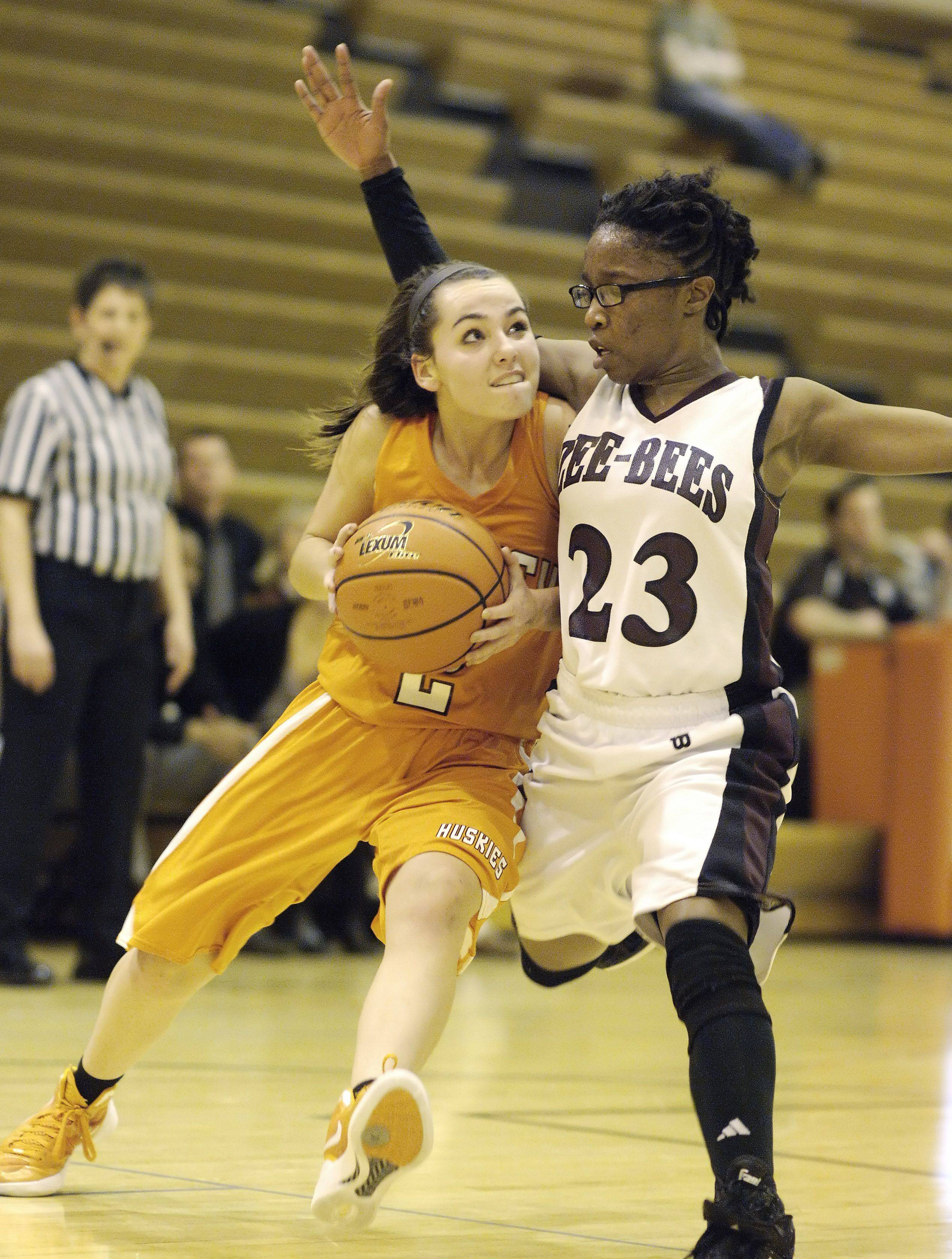 Hersey's Jen Hall tries to make her way past Zion-Benton's Shania Thompson .