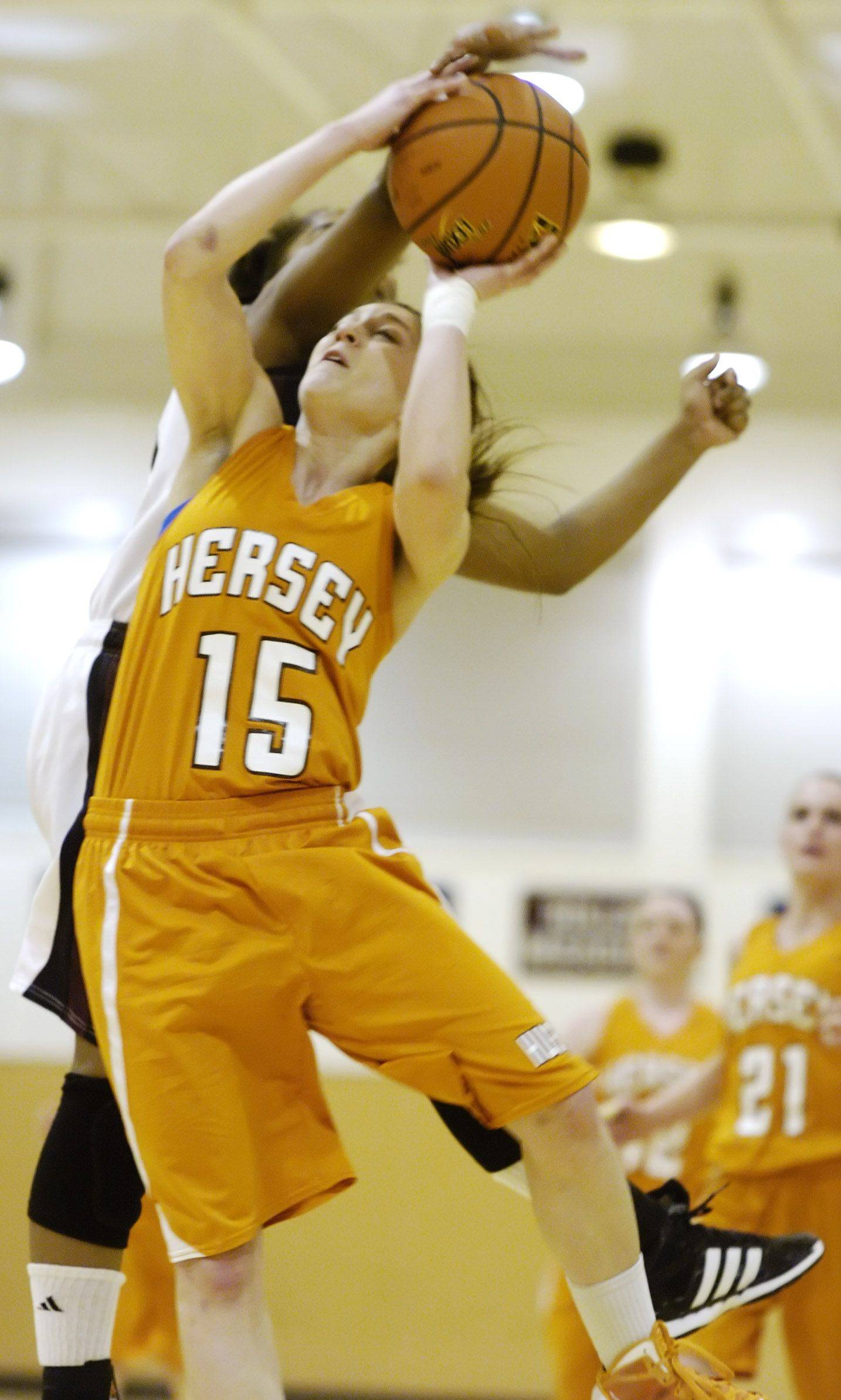 Hersey's Corinne Busby draws contact on her way to the basket.