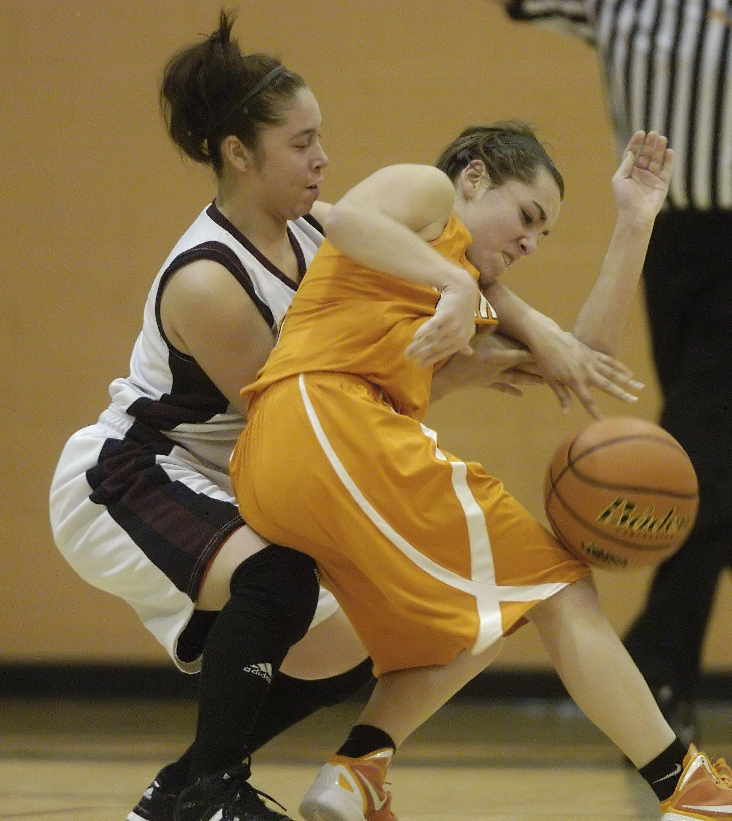 Hersey's Jen Hall, right, draws contact from Zion-Benton's Carlie Fernandez during Wednesday's regional semifinal at Hersey.