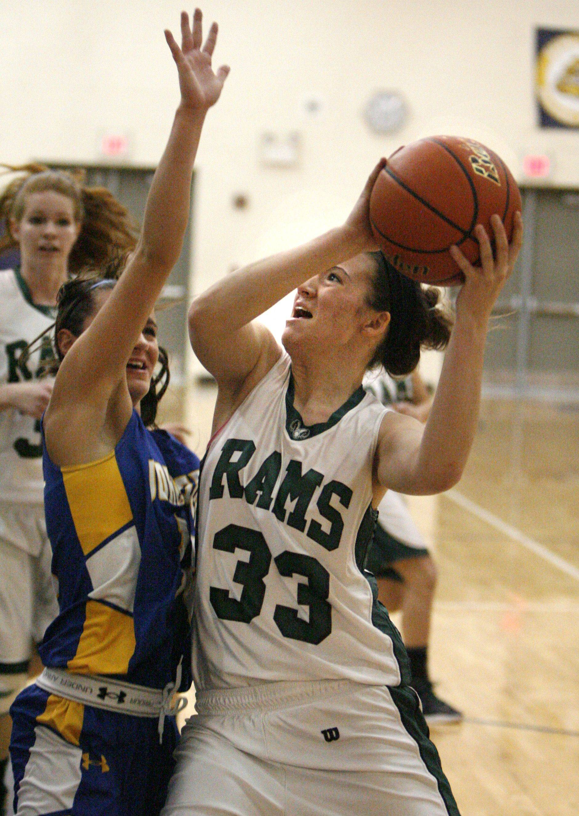 Grayslake Central's Skyler Jessop drives the lane to shoot against Johnsburg in Class 3A regional final play Friday.