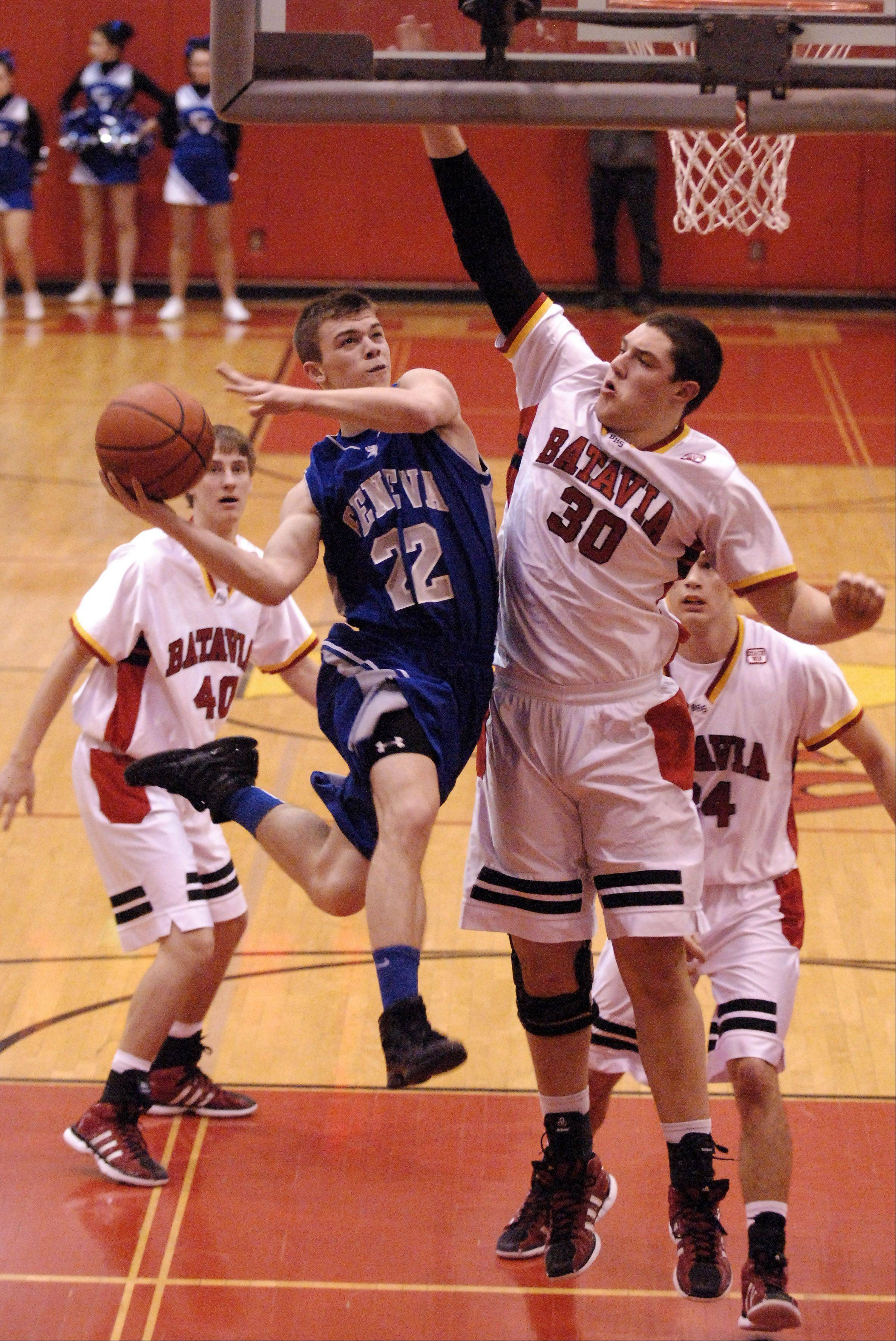 Geneva's Ryan Willing drives to the basket but is thwarted by the defense of Batavia's Cole Gardner.