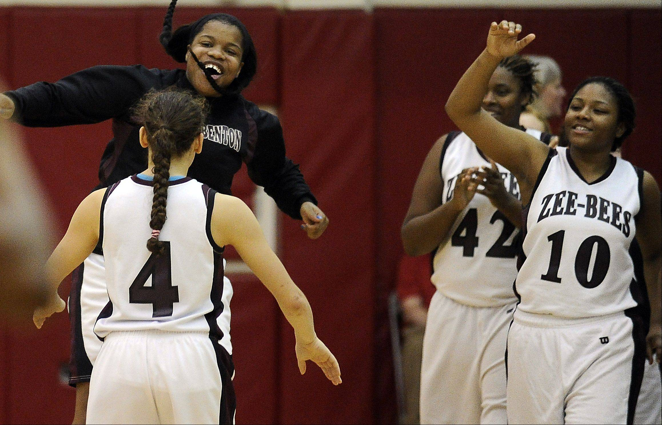Zion-Benton players celebrate their win over Stevenson in girls varsity basketball sectional semi-finals at Palatine High School on Monday.