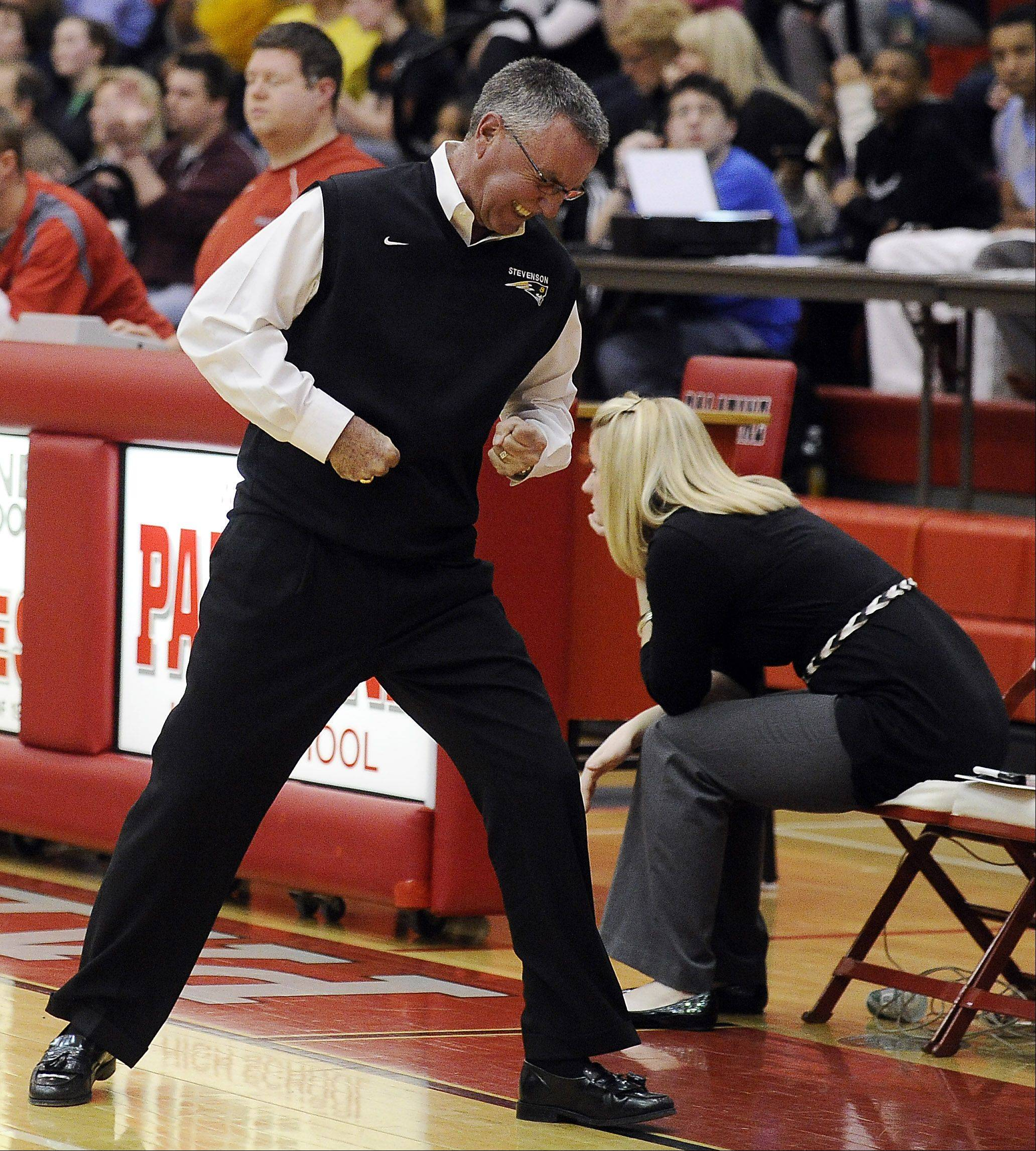 Stevenson coach Tom Dineen shows his frustration on a missed opportunity from his players as his team falls to Zion-Benton's in a sectional semifinal at Palatine High School on Monday.