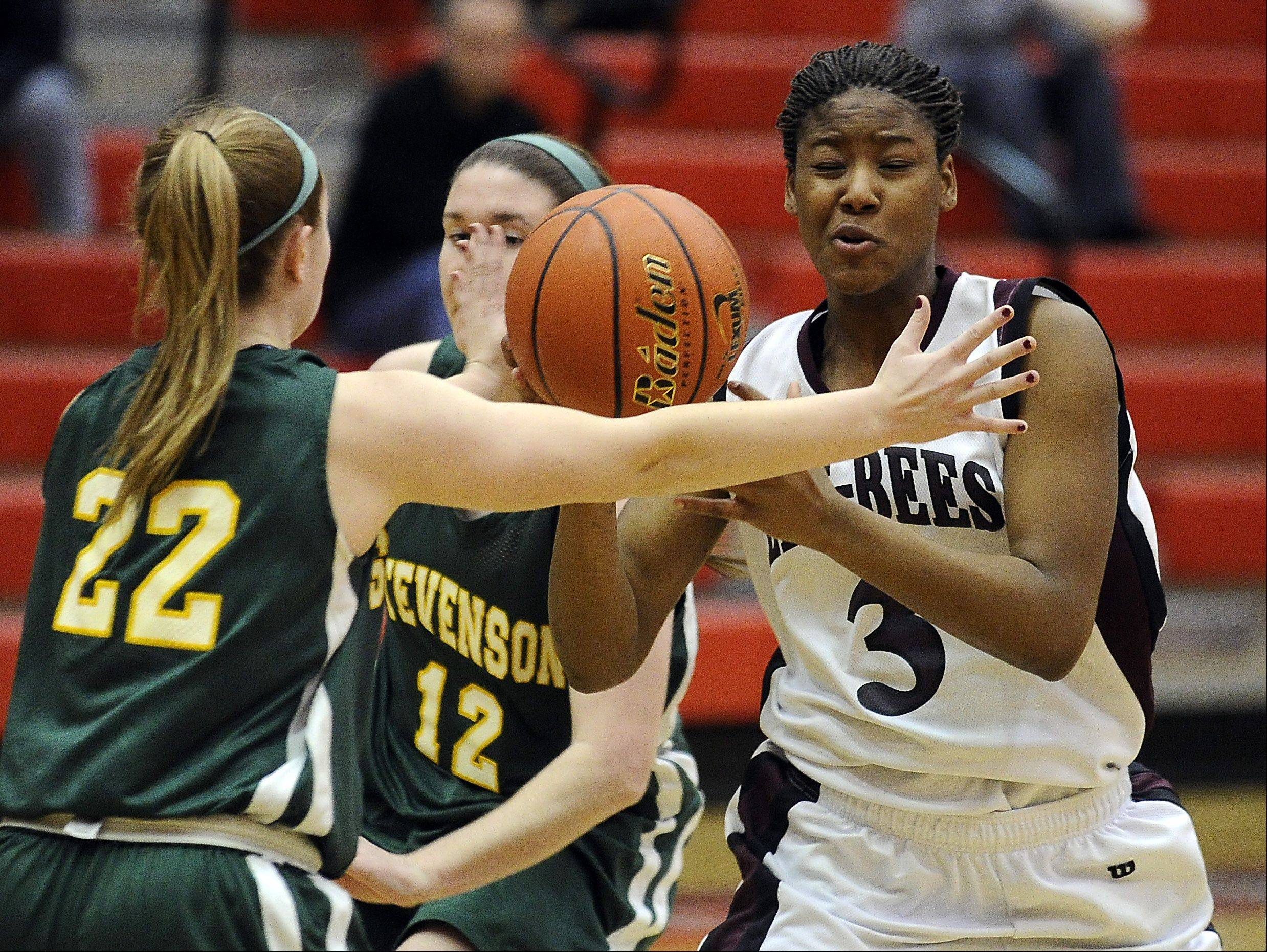 Stevenson's Katherine Moffat knocks the ball out-of-the-hands of Zion-Benton's Octavia Crump in the first quarter of the sectional semifinal play at Palatine on Monday.