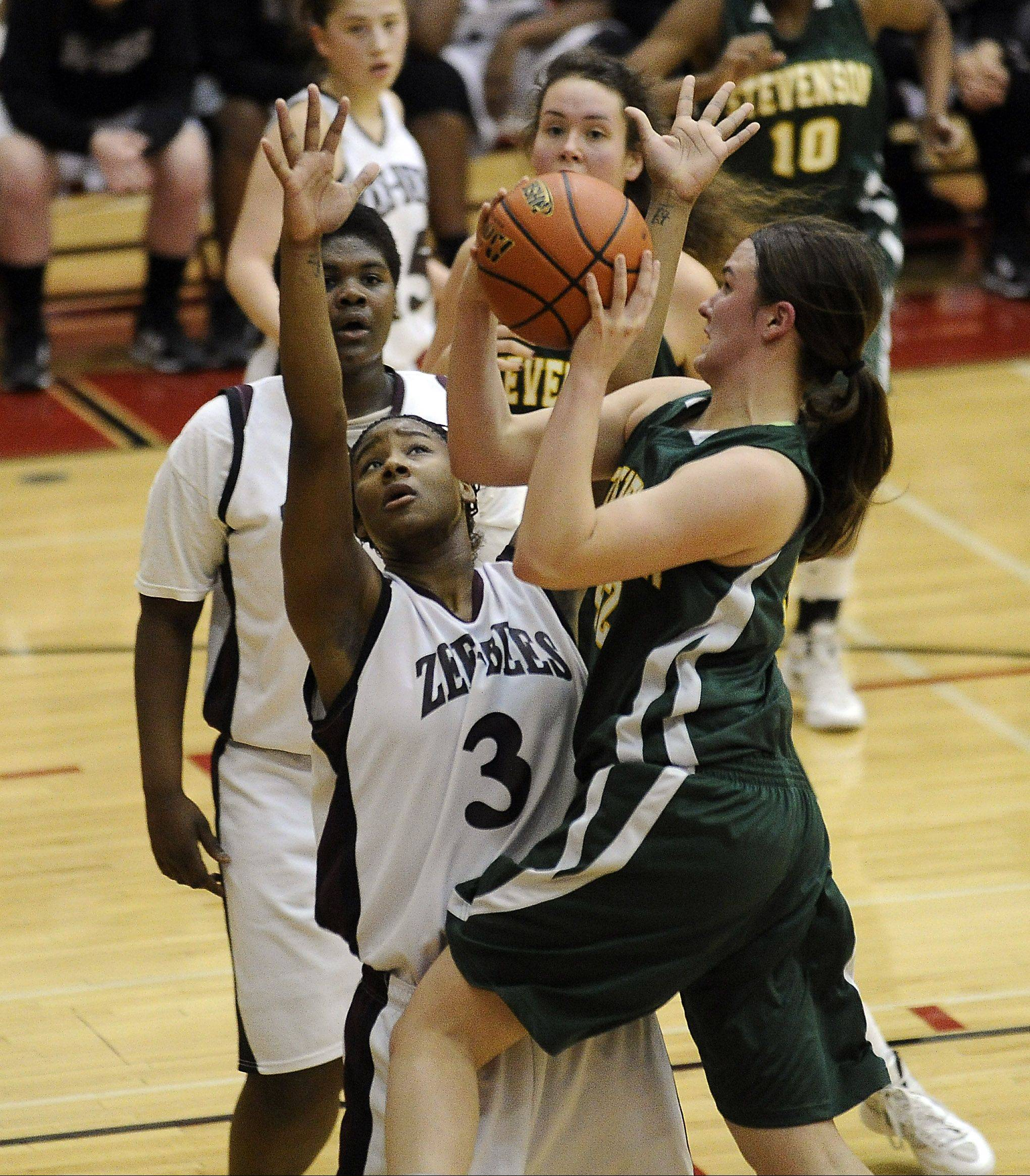 Stevenson's Alexandra Elzinga powers her way to the basket as Zion-Benton's Octavia Crump tries to block the shot in sectional semifinal play at Palatine on Monday.