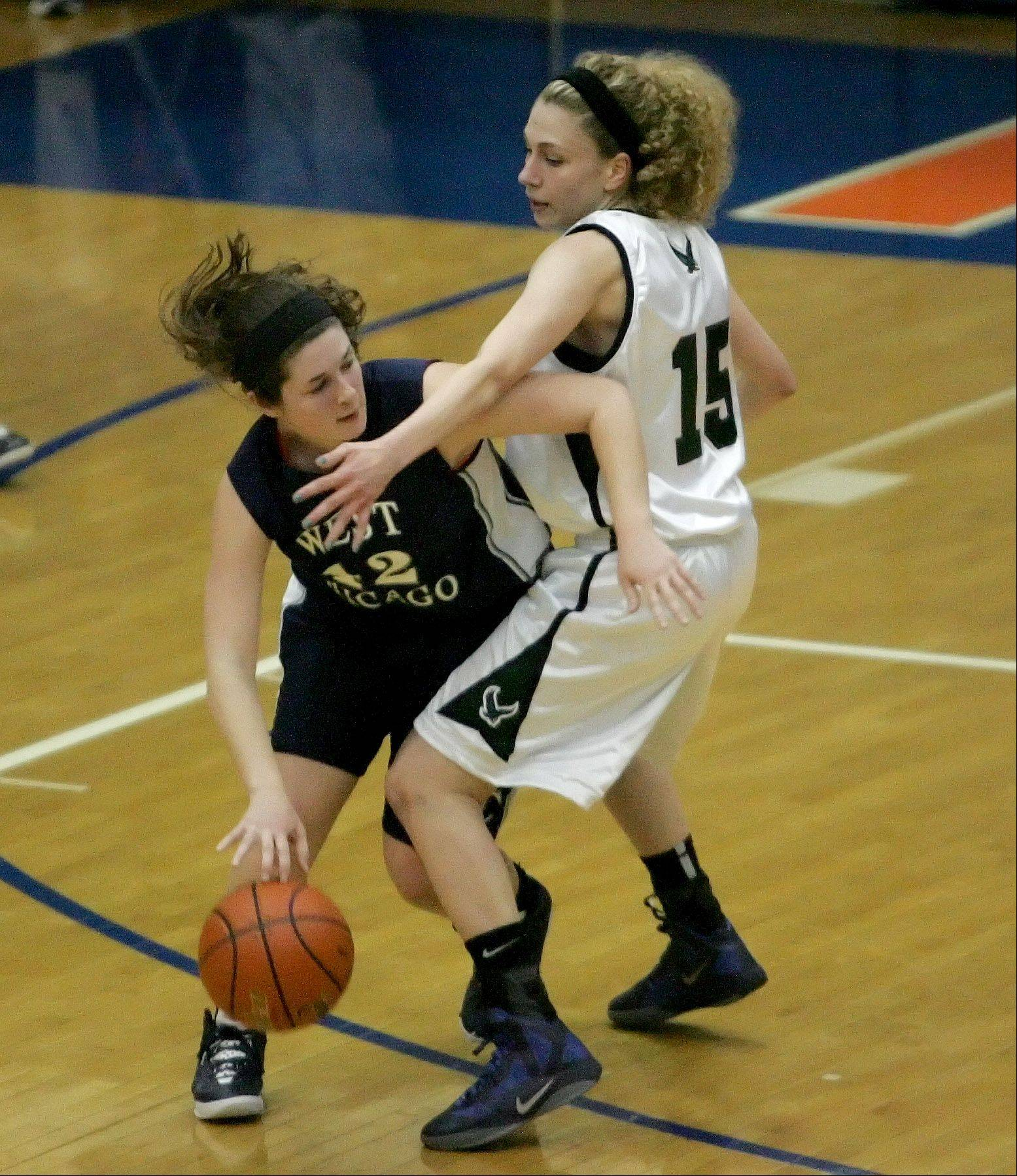 Emily Warkins of West Chicago, left, moves around Katie Gutzwiller of Bartlett in Class 4A sectional semifinal girls basketball action at Hoffman Estates on Monday.