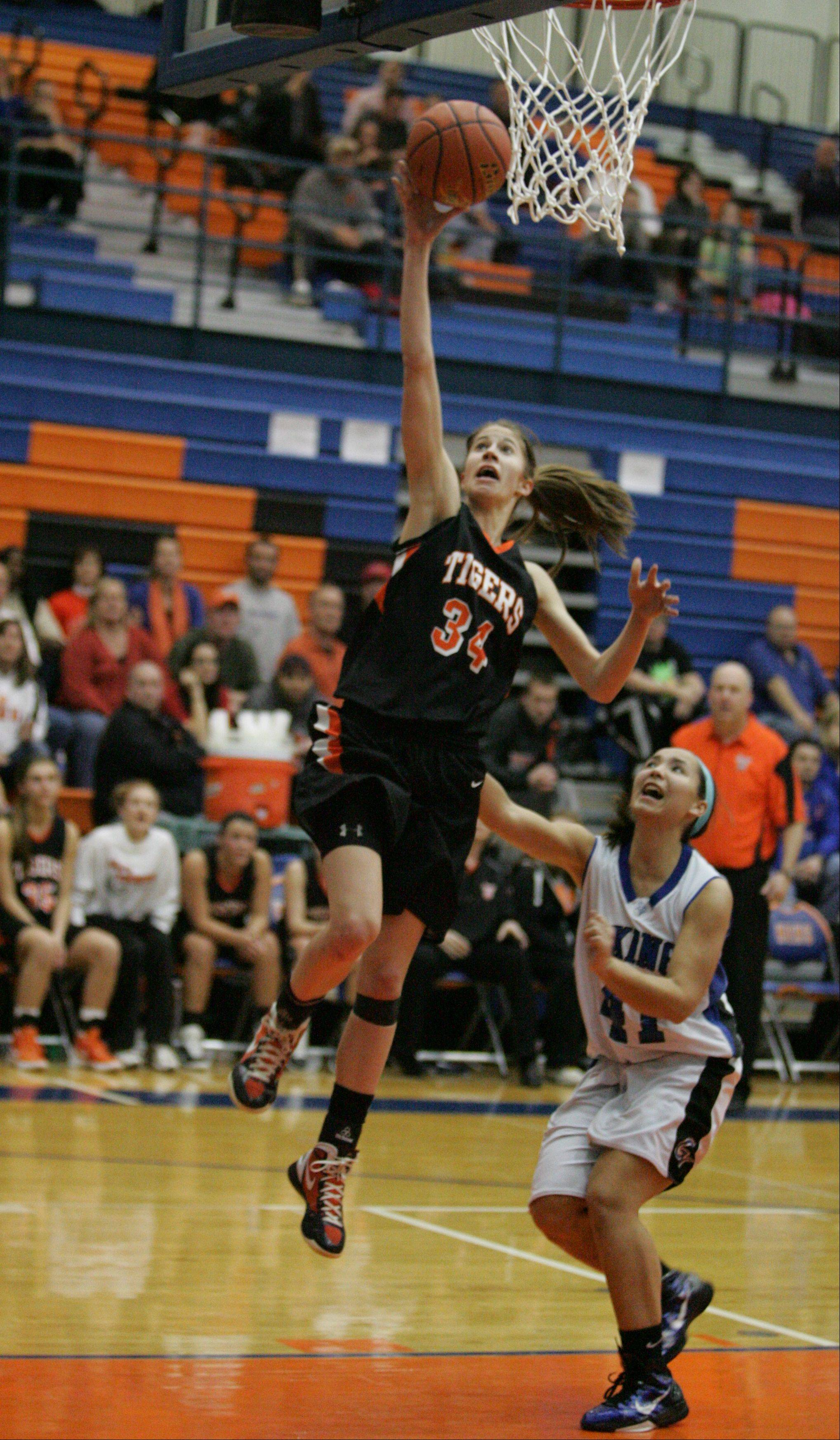 Geneva vs. Wheaton Warrenville South Monday night in Class 4A girls basketball sectlional semifinals in Hoffman Estates.