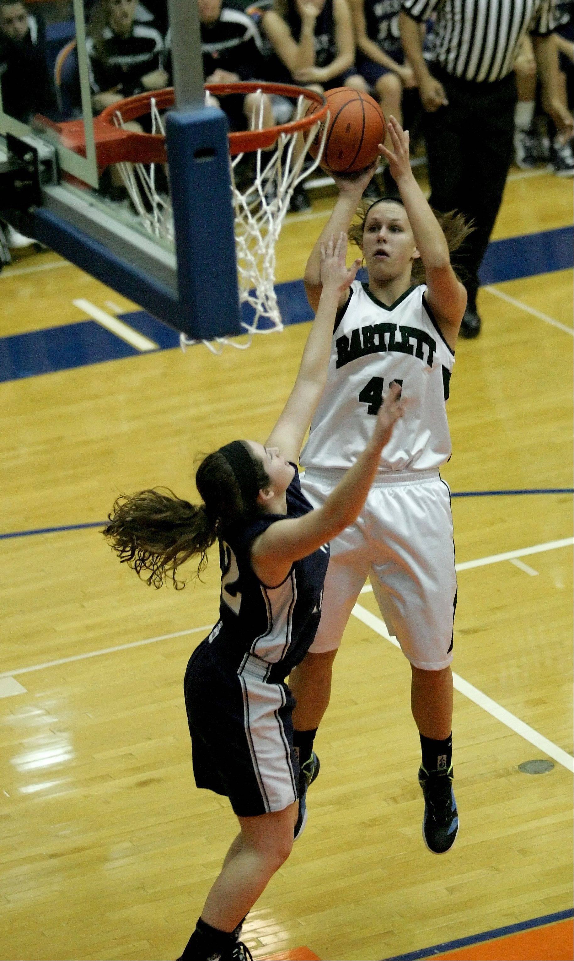 Lisa Palmer of Bartlett shoots the ball over Emily Warkins of West Chicago.