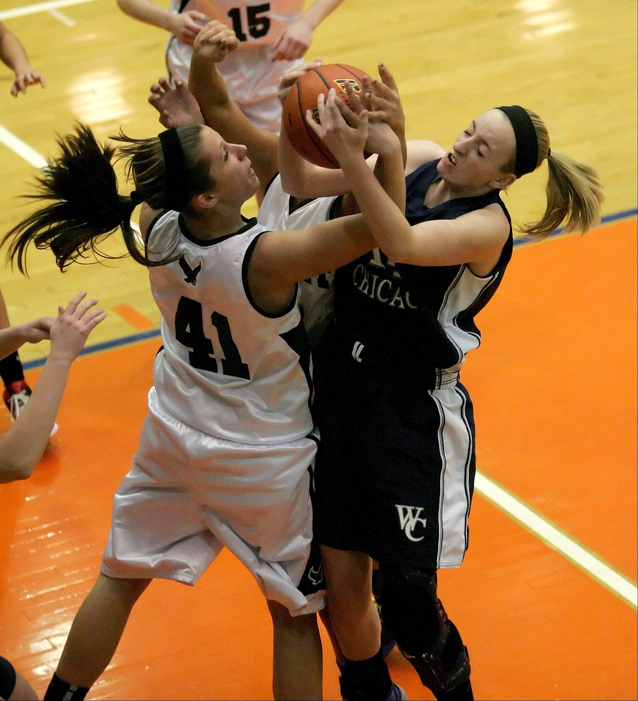 Lisa Palmer of Bartlett, left, and Brenna MacDonald of West Chicago, right, go after a rebound.