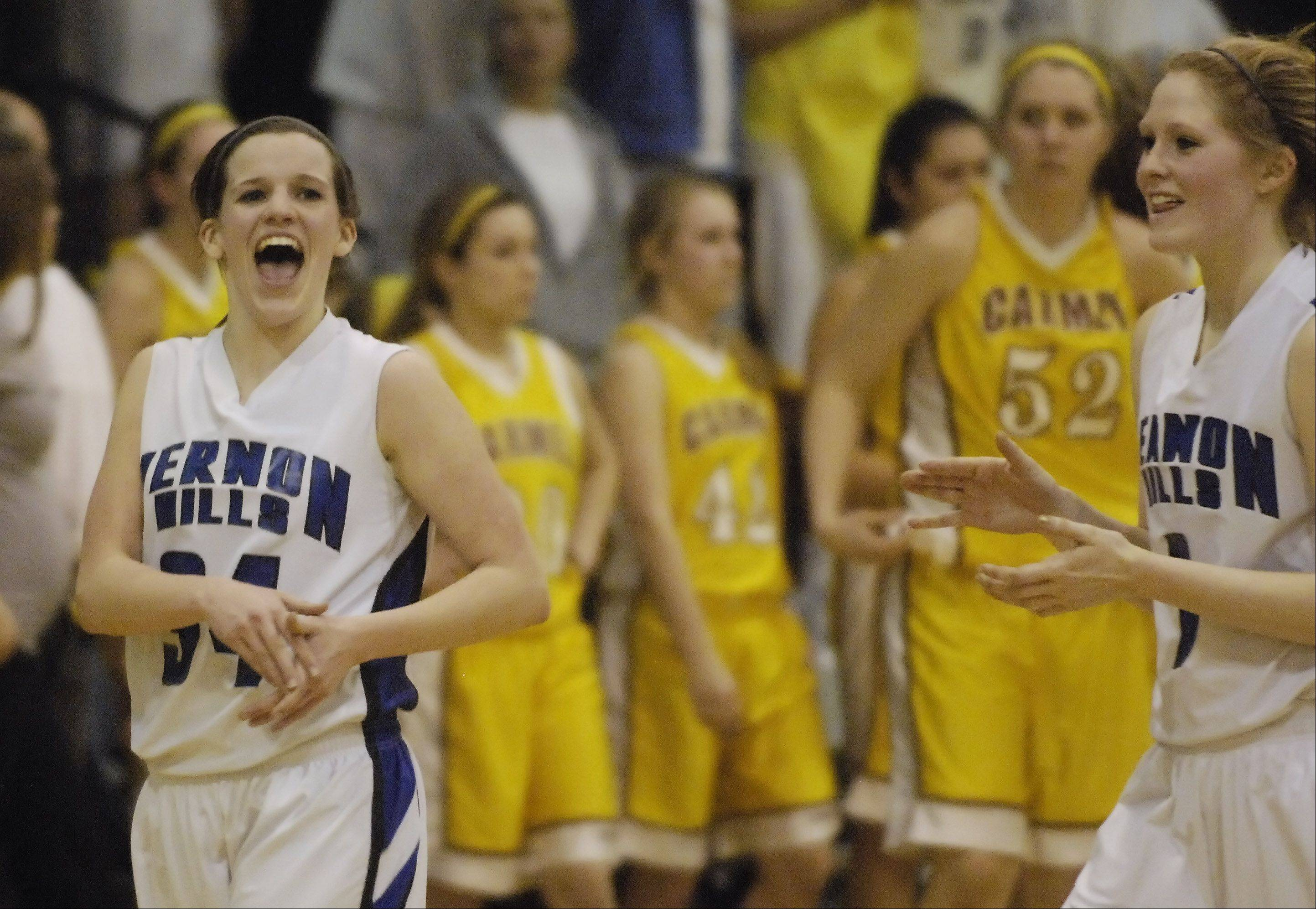 Vernon Hills' Abby Springer, left, and teammate Sydney Smith celebrate their team's victory over Carmel.