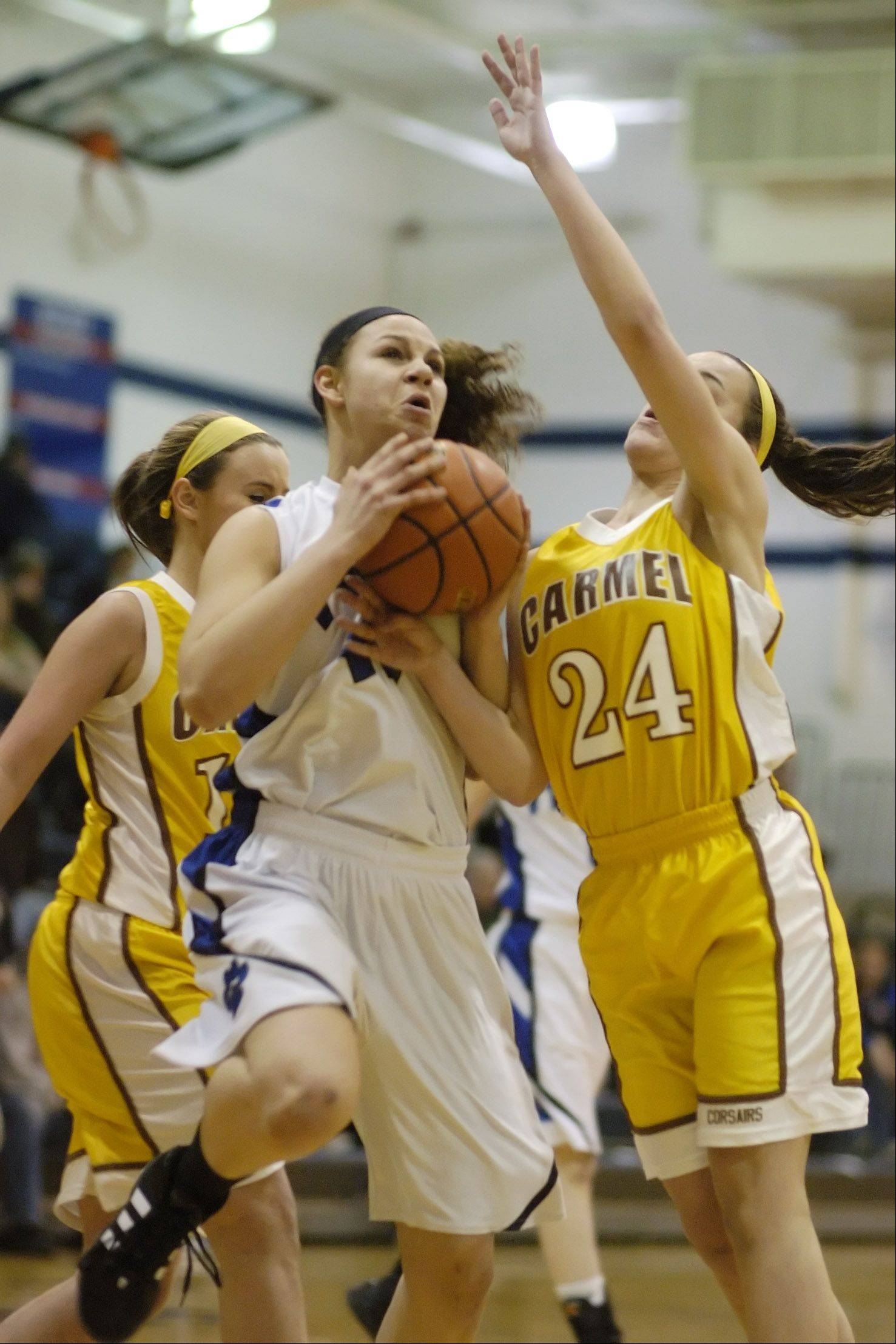 Lauren Webb of Vernon Hills, left, tries to drive past Kaitlyn Lynch of Carmel.