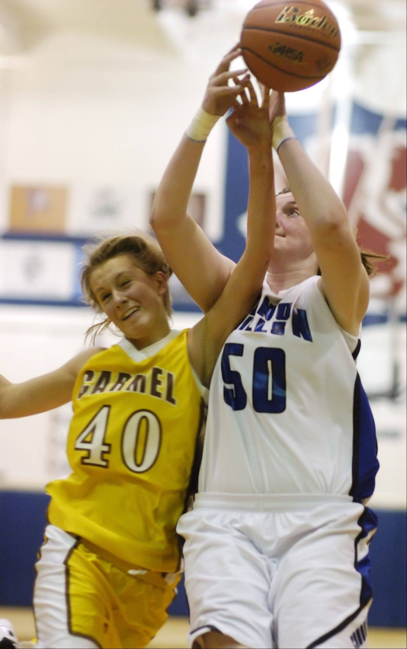Carmel's Leah Lach, left, and Vernon Hills' Meri Bennett-Swanson make contact.