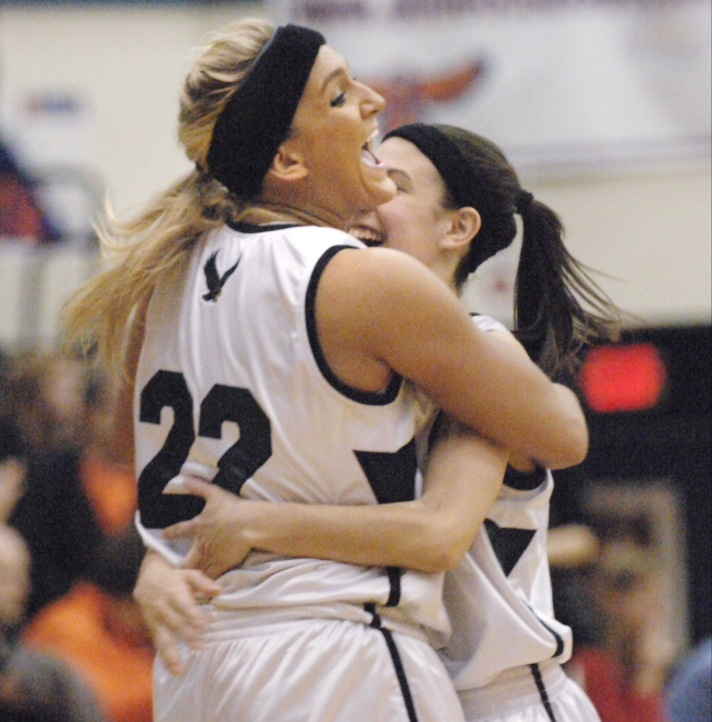 John Starks/jstarks@dailyherald.com Bartlett's Haley Videckis and Janessa Baker, right, hug after beating Wheaton Warrenville South's in Thursday's Class 4A Hoffman Estates sectional championship game.
