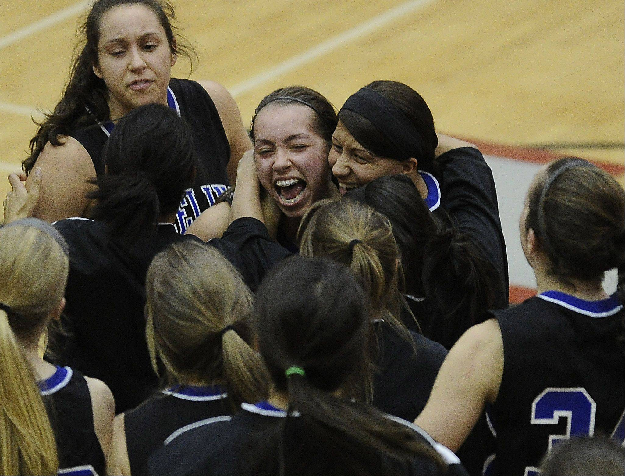 Wheeling's Deanna Kuzmanic celebrates the Wildcats' victory over Zion-Benton with the rest of her teammates in the Class 4A sectional final at Palatine High School on Thursday.