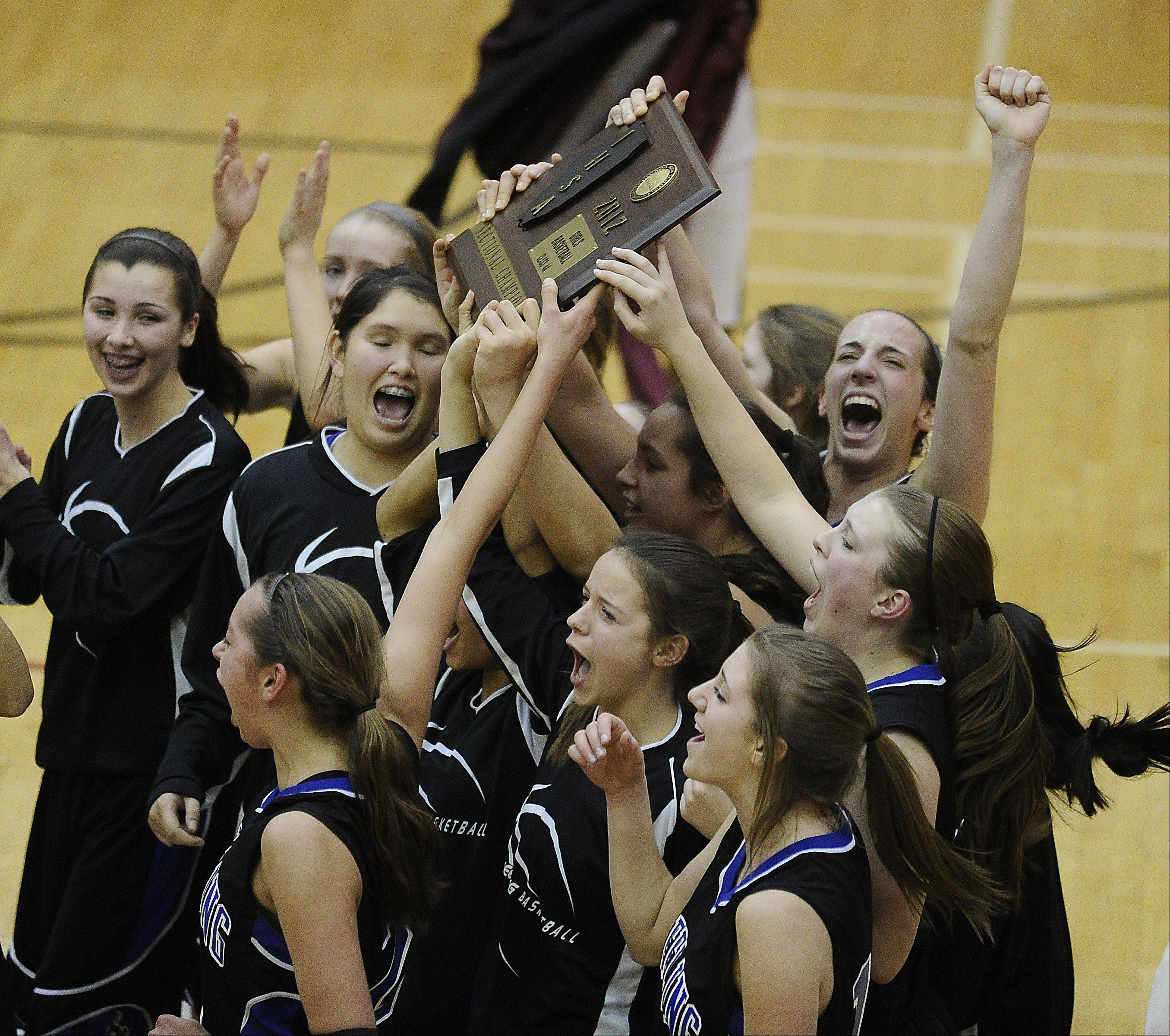 Wheeling celebrates its victory over Zion-Benton in the Class 4A sectional final at Palatine High School on Thursday.