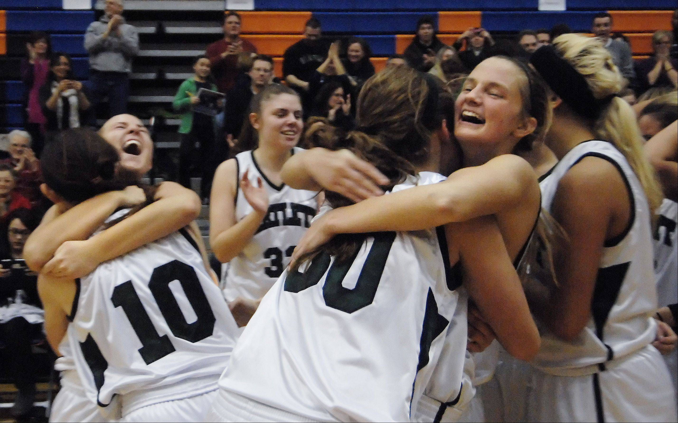 Bartlett's Alexandra Fleig, left, Nicole Gobbo, 10, Lisa Palmer and Kristin Conniff, right, hug after beating Wheaton Warrenville South in Thursday's Class 4A Hoffman Estates sectional championship game.