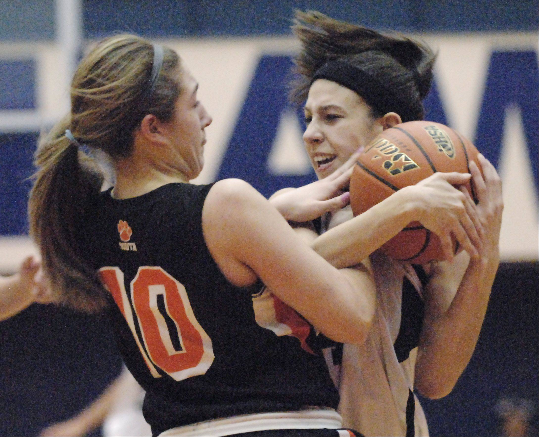 Bartlett's Janessa Baker, right, and Wheaton Warrenville South's Sierra Bisso struggle for the ball during Thursday's Class 4A Hoffman Estates sectional championship game.