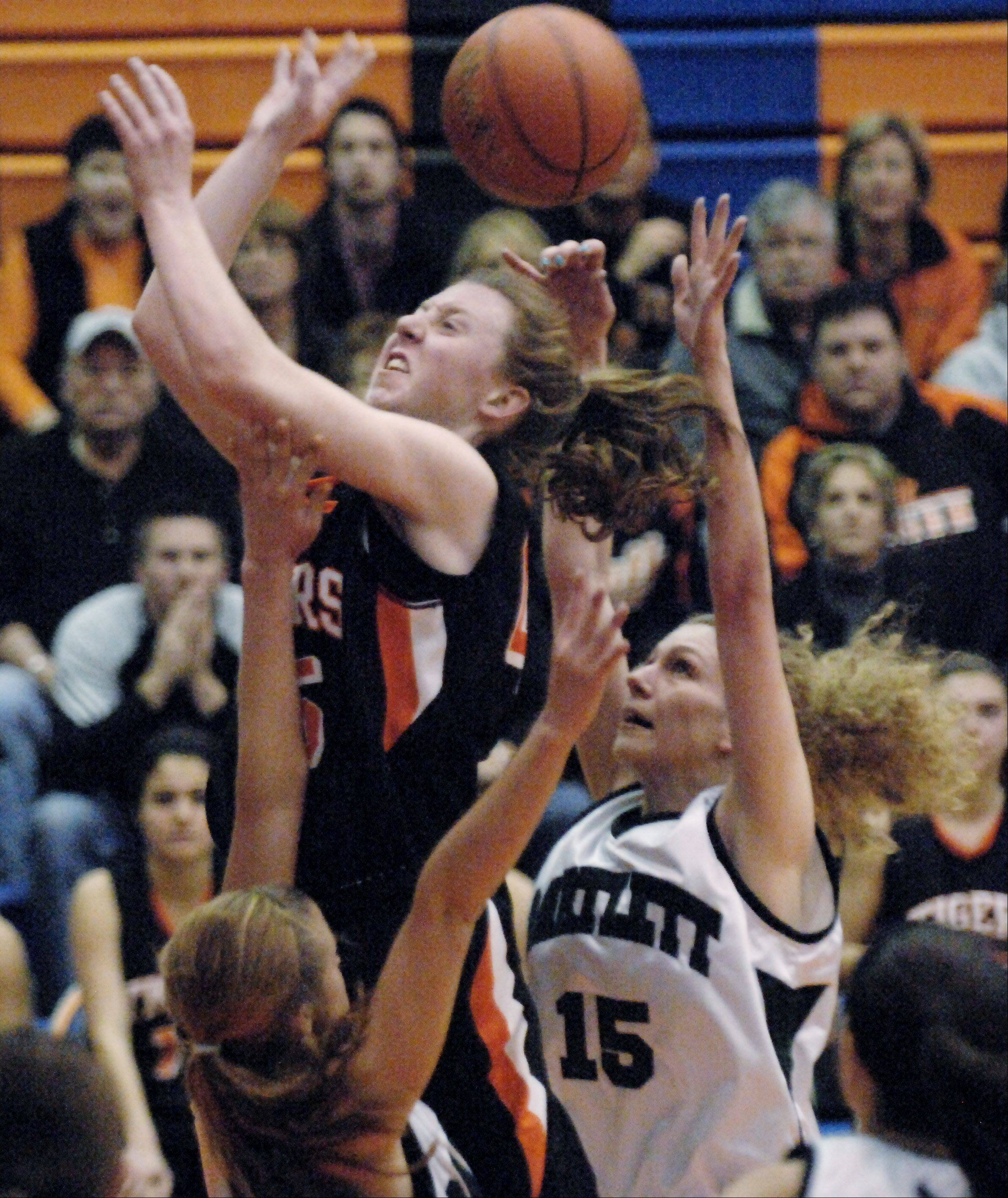 Wheaton Warrenville South's Meghan Waldron has the ball stripped by Barltett's Katie Gutzwiller as the drives to the basket during Thursday's Class 4A Hoffman Estates sectional championship game.