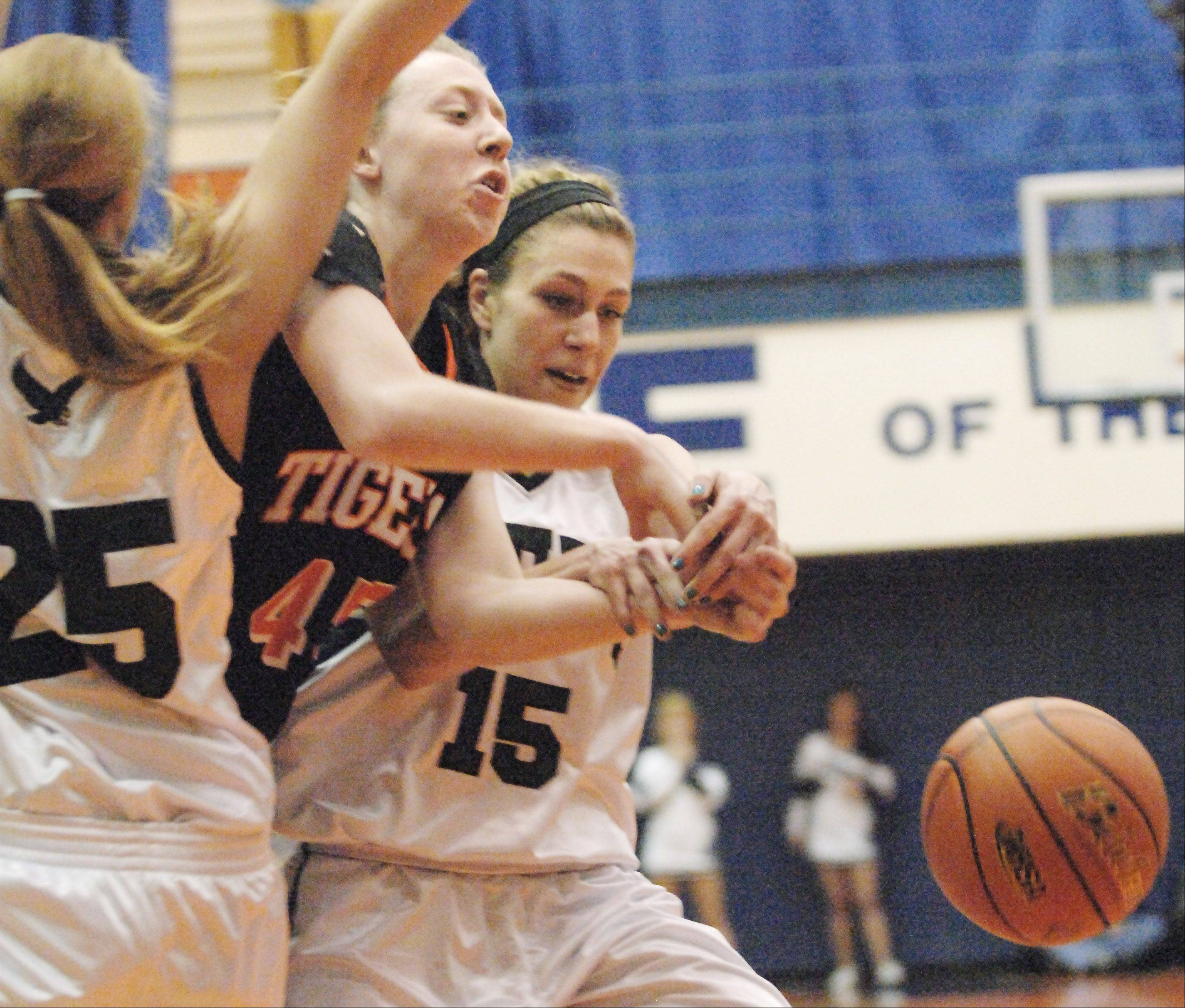 Wheaton Warrenville South's Meghan Waldron loses the ball out-of-bounds as she is guarded by Bartlett's Kristin Conniff and Katie Gutzwiller, right, during Thursday's Class 4A Hoffman Estates sectional championship game.